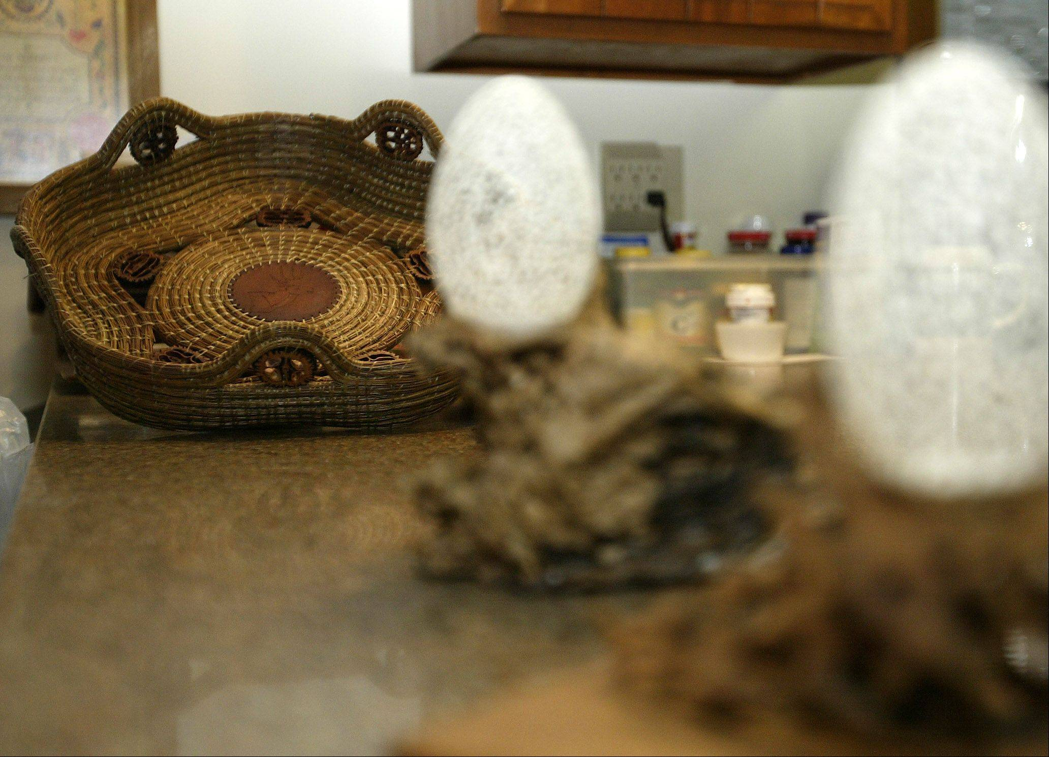 John Warnock of Gilberts began making pine needle baskets and carving eggshells about five years ago. He can finish an egg in approximately two weeks and a basket in anywhere from one to three weeks depending on the stitching pattern he uses.