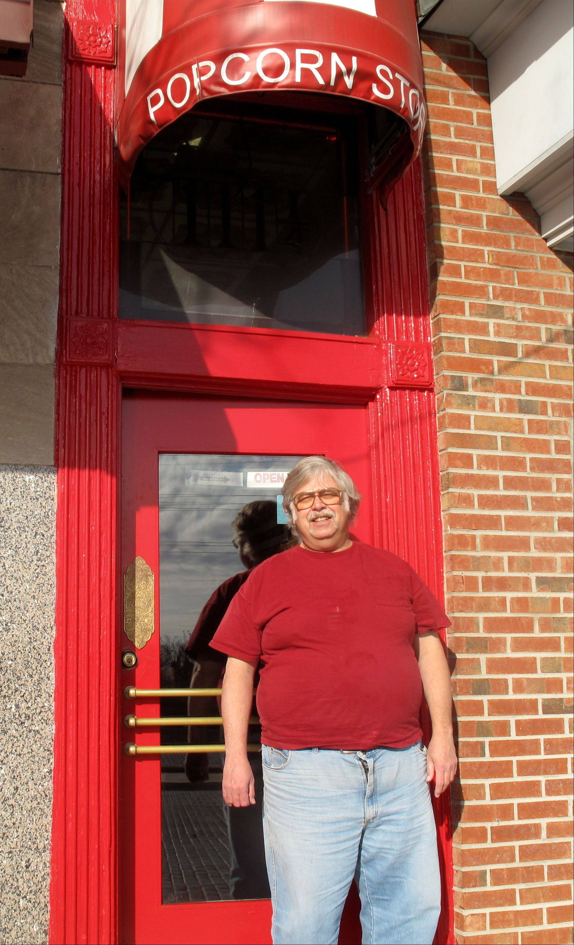 Owner Bill Wakefield in front of the narrow door that leads into the Little Popcorn Store.
