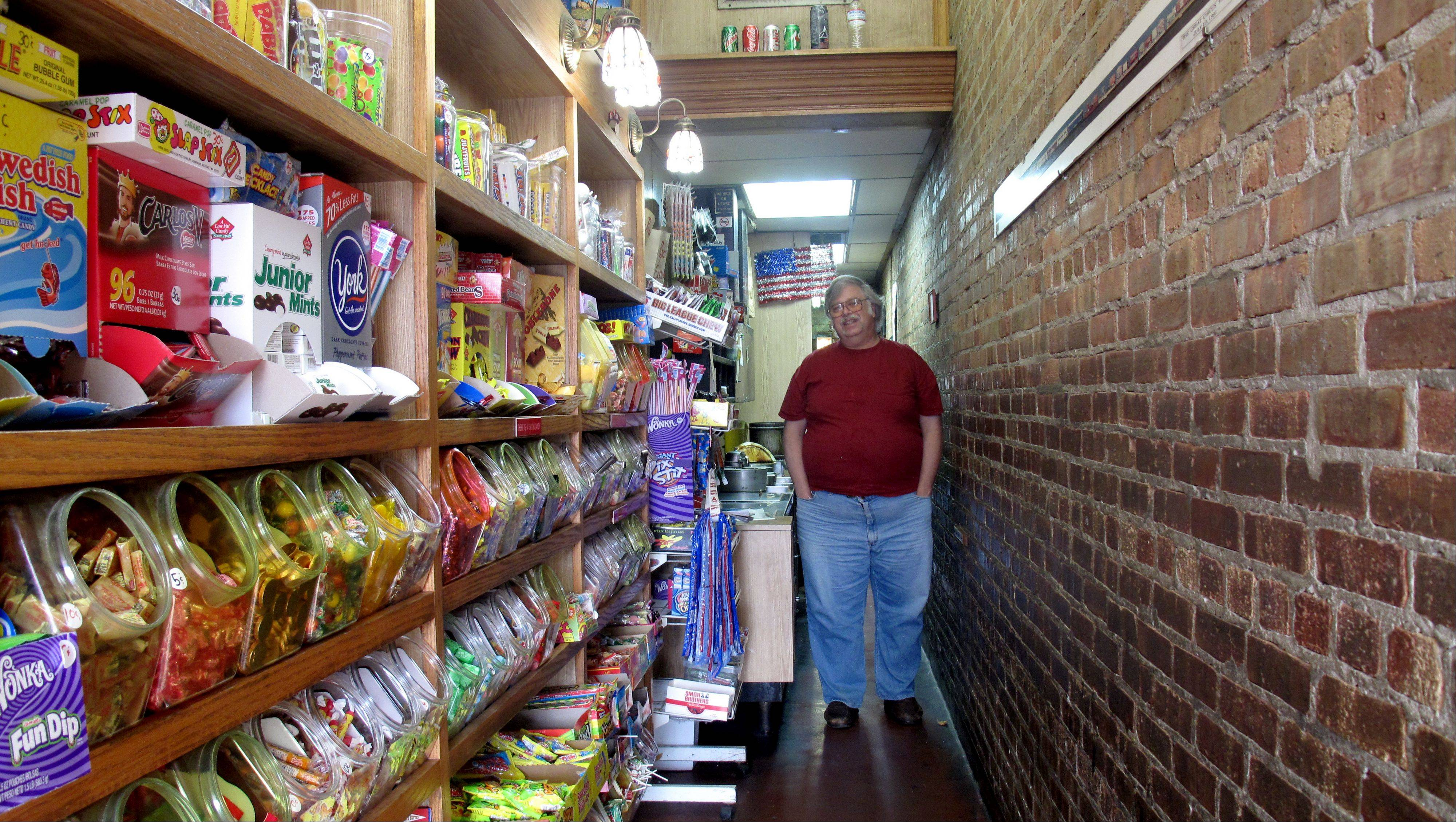 The Little Popcorn Store in downtown Wheaton has been around 90 years and still sits in a four-foot-wide alleyway between two buildings. When more than one customer enters the store, they must remain in single file to fit.