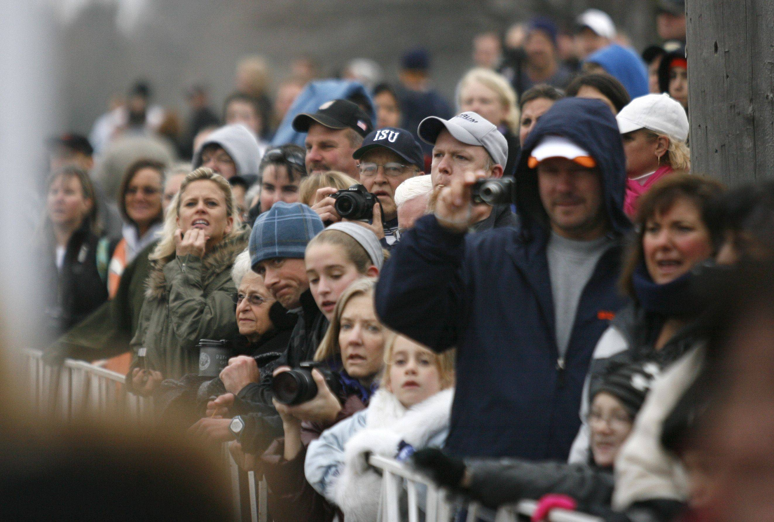 Hundreds line the course Thursday morning to cheer participants in the Naperville Turkey Trot.