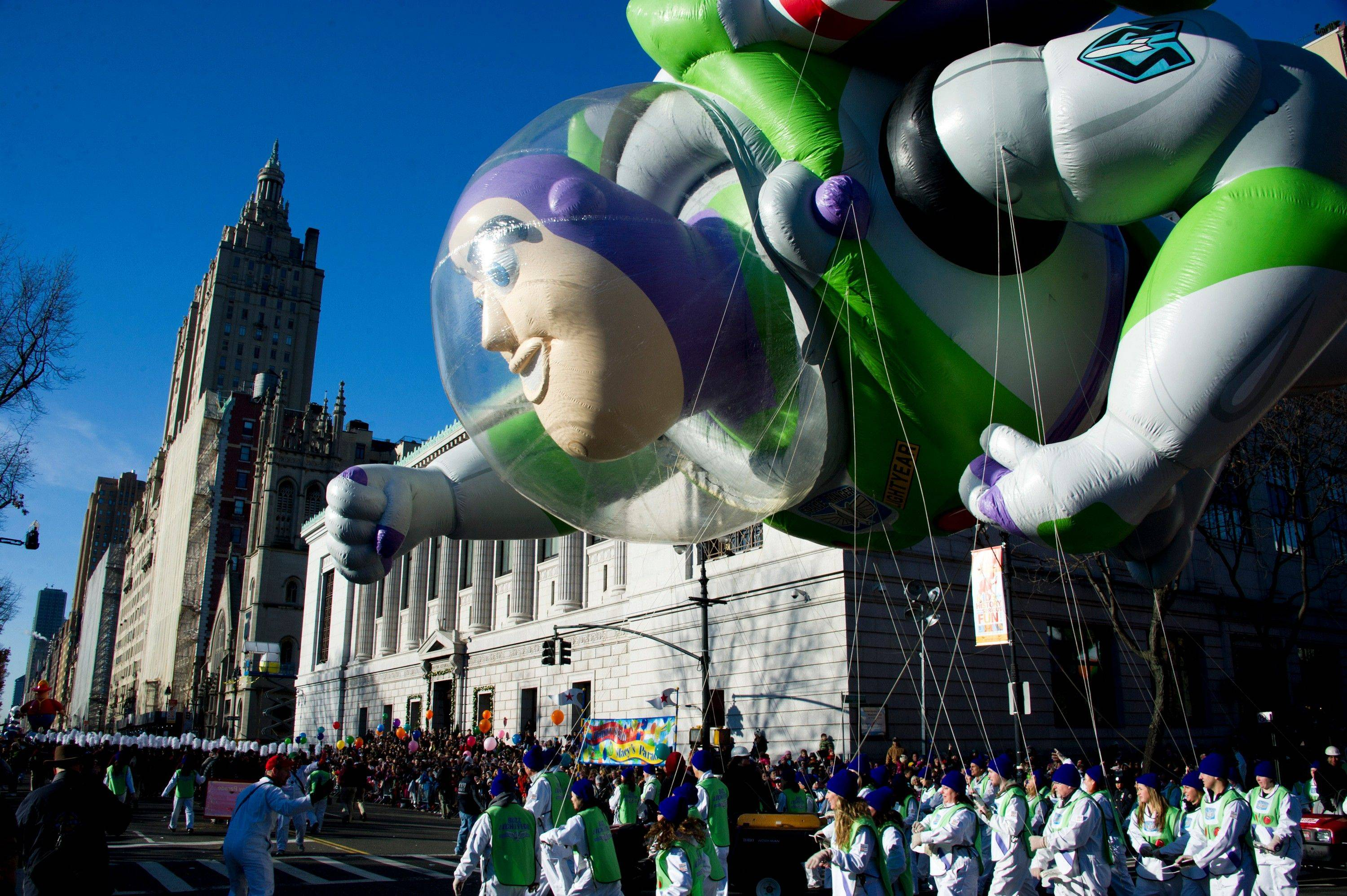 The Buzz Lightyear balloon floats in the Macy's Thanksgiving Day Parade in New York, Thursday, Nov. 24, 2011. A jetpack-wearing monkey and a freakish creation from filmmaker Tim Burton are two of the big new balloons that will make their inaugural appearances in front of millions of people at this year's parade.