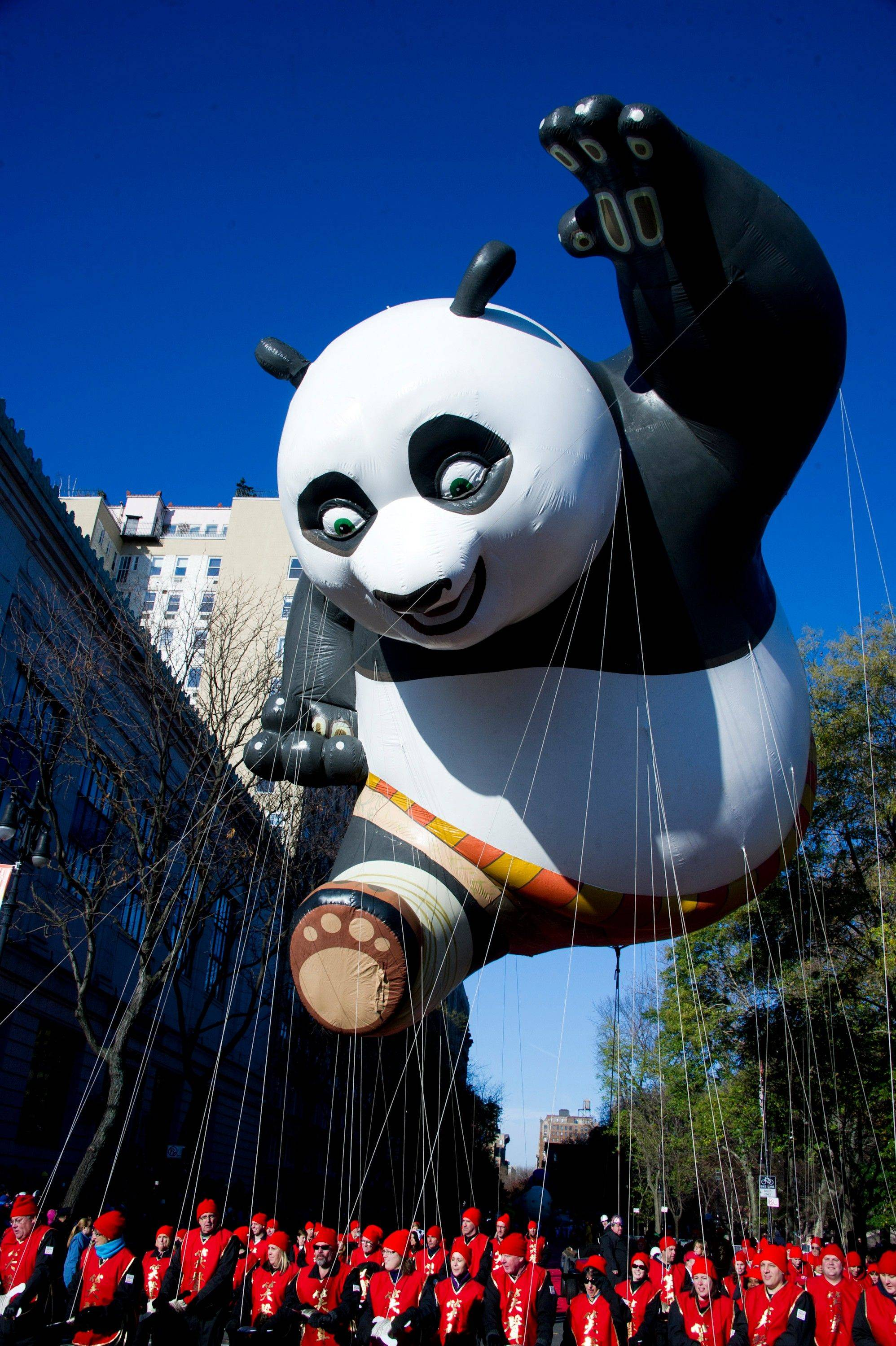 The Kung Fu Panda balloon floats in the Macy's Thanksgiving Day Parade in New York, Thursday, Nov. 24, 2011. A jetpack-wearing monkey and a freakish creation from filmmaker Tim Burton are two of the big new balloons that will make their inaugural appearances in front of millions of people at this year's parade.