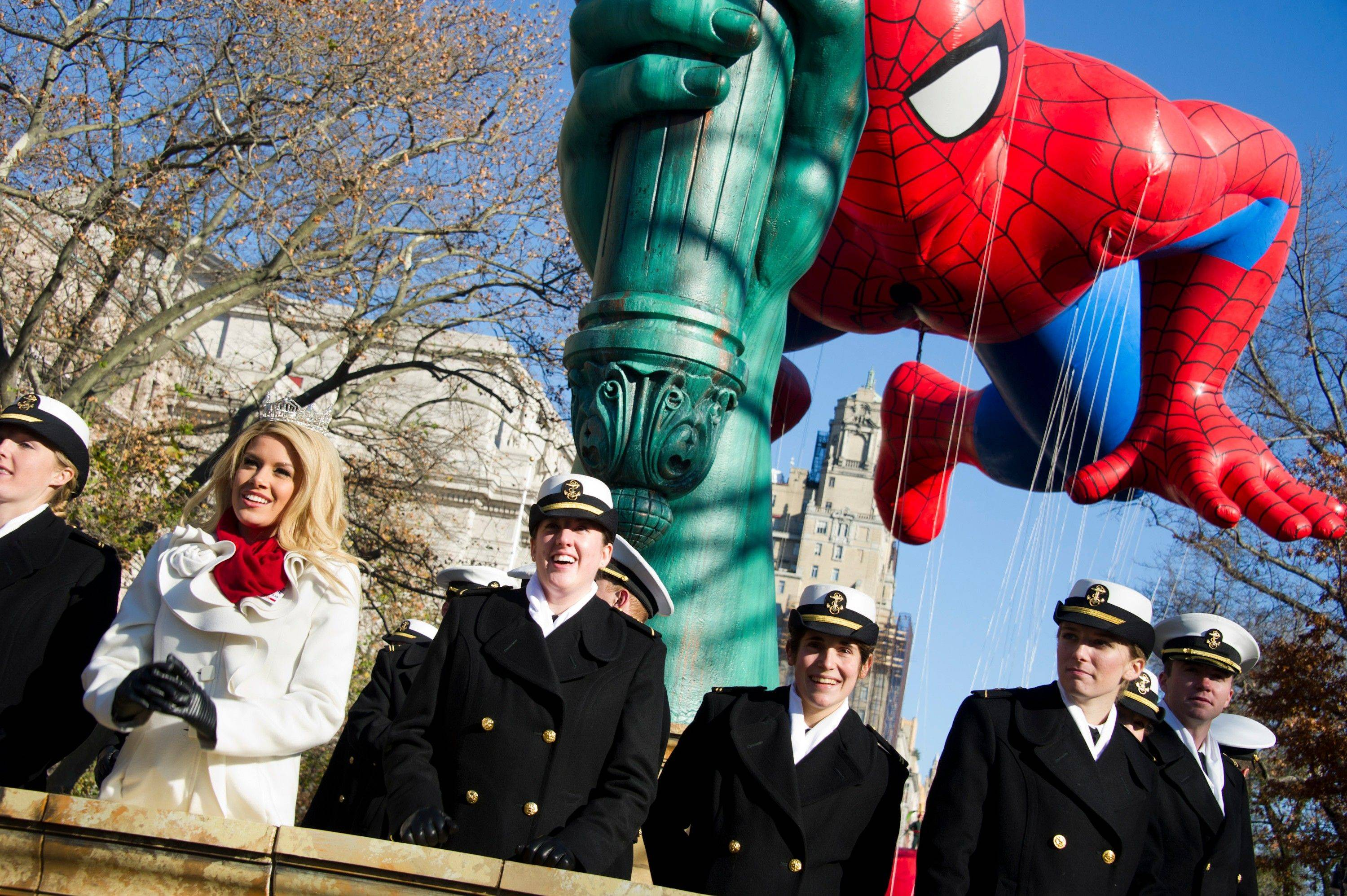 Miss America Teresa Scanlan rides a float in the Macy's Thanksgiving Day Parade in New York, Thursday, Nov. 24, 2011 A jetpack-wearing monkey and a freakish creation from filmmaker Tim Burton are two of the big new balloons that will make their inaugural appearances in front of millions of people at this year's parade.