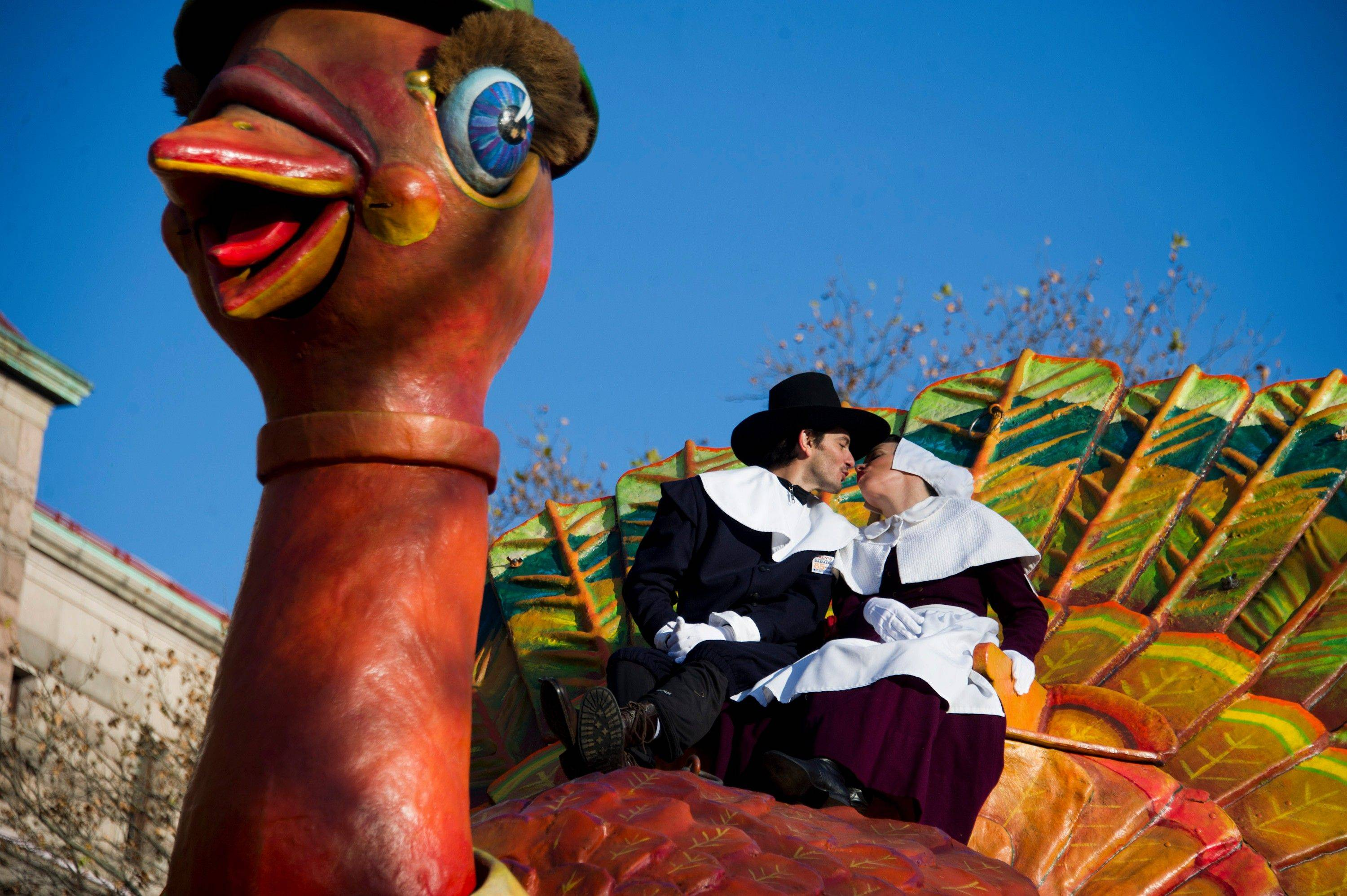 Gabriele Corcos and Debi Mazar ride a float in the Macy's Thanksgiving Day Parade in New York, Thursday, Nov. 24, 2011.
