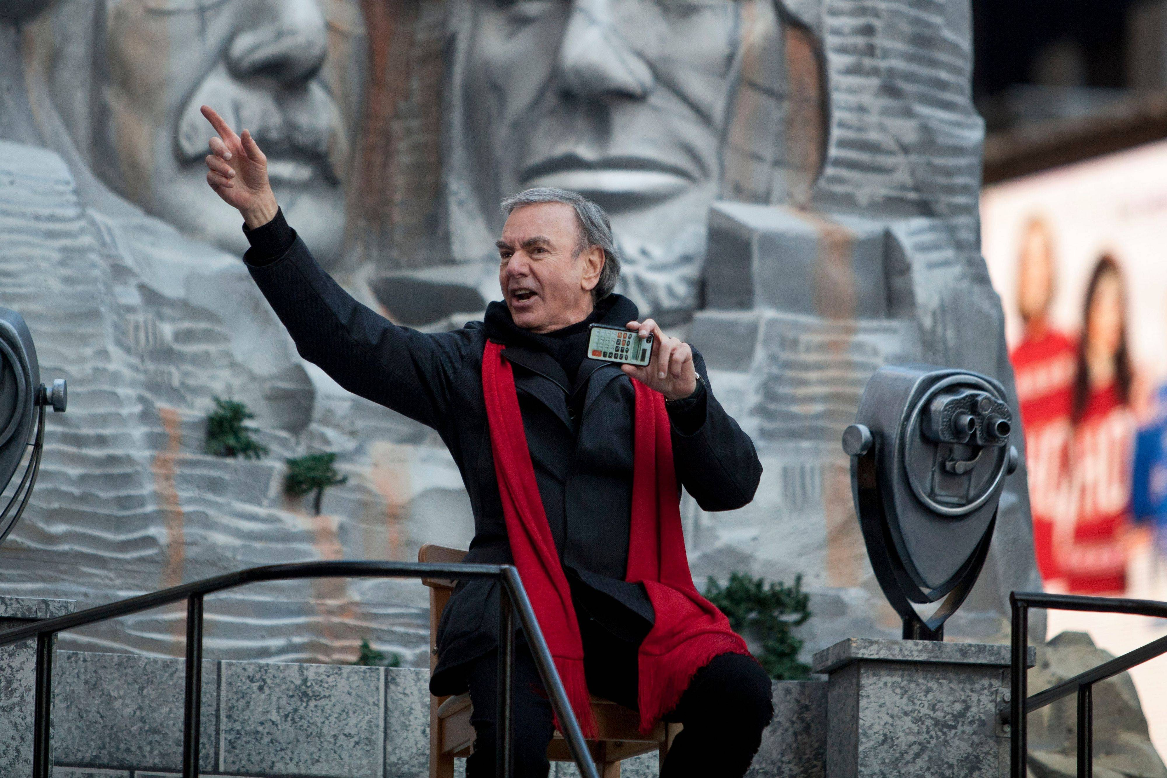 Musician Neil Diamond rides a float during the Macy's Thanksgiving Day Parade in Times Square in New York on Thursday, Nov. 24, 2011. The parade premiered in 1924, this is its 85th year.
