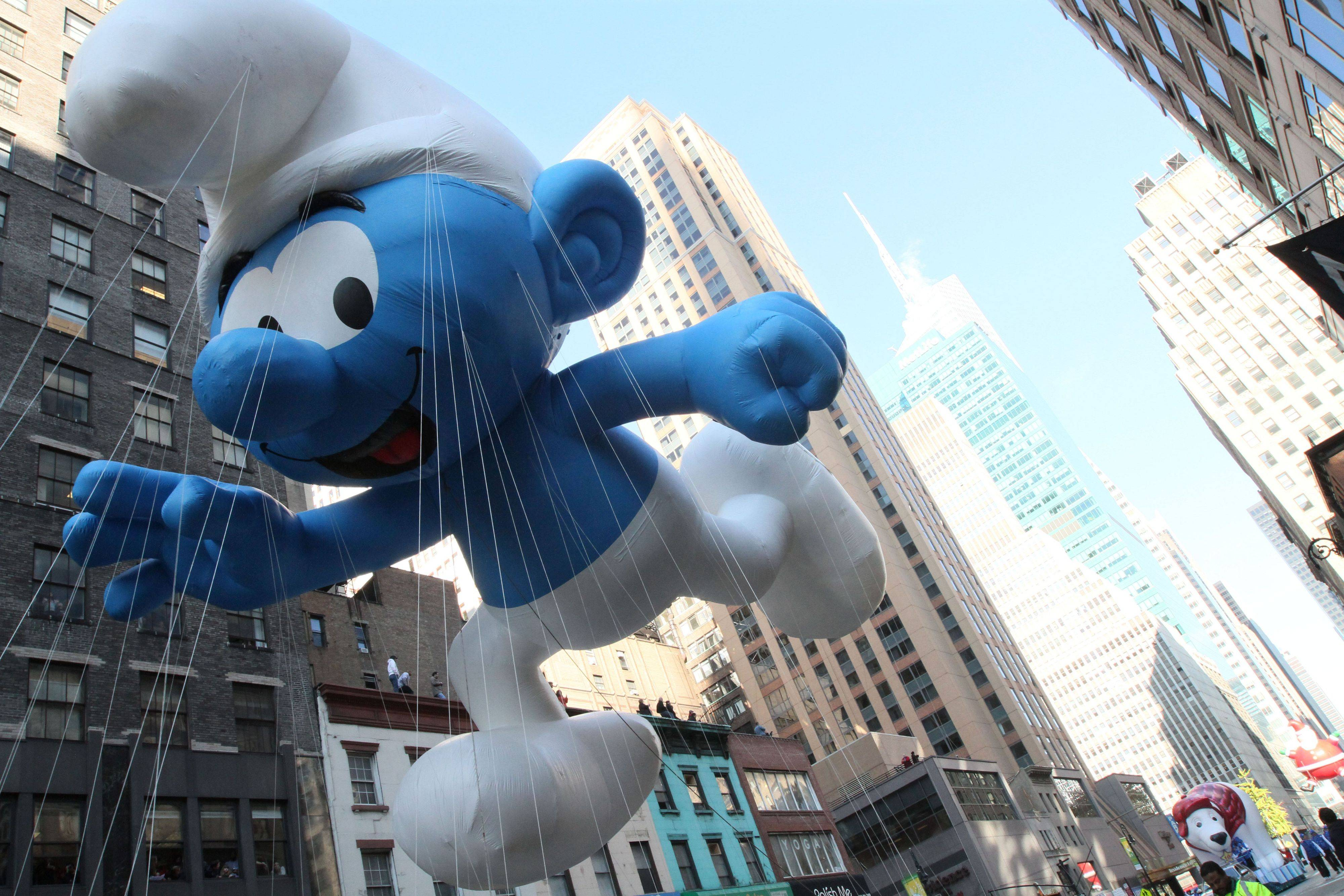 The Smurf balloon makes its way down New York's Sixth Avenue as it takes part in the 85th Annual Macy's Thanksgiving Day Parade Thursday Nov. 24, 2011.