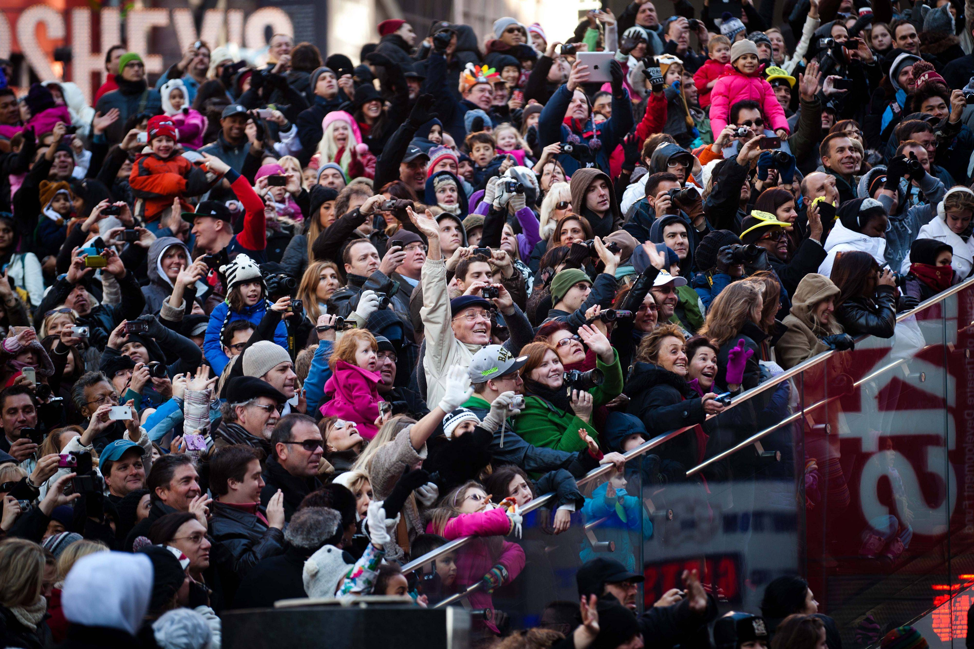 Crowds look on as the Santa Claus float makes its way through Times Square during the Macy's Thanksgiving Day Parade, Thursday, Nov. 24, 2011, in New York. A jetpack-wearing monkey and a freakish creation from filmmaker Tim Burton are two of the big new balloons that will make their inaugural appearances in front of millions of people at this year's parade.