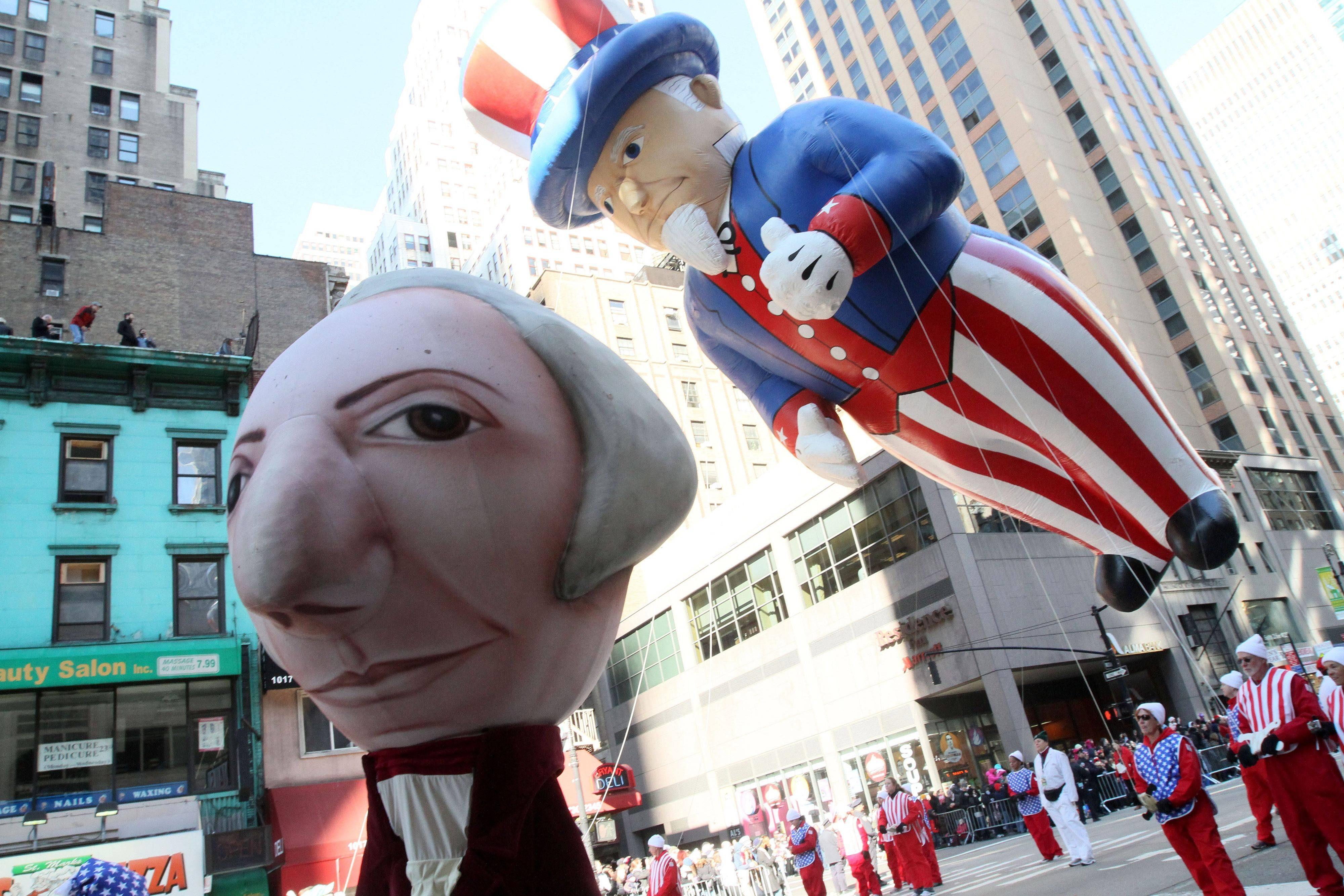 The Uncle Sam balloon, right, and other participants in the 85th Annual Macy's Thanksgiving Day Parade make their way down New York's Sixth Avenue Thursday, Nov. 24, 2011.A jetpack-wearing monkey and a freakish creation from filmmaker Tim Burton are two of the big new balloons that will make their inaugural appearances in front of millions of people at this year's parade.