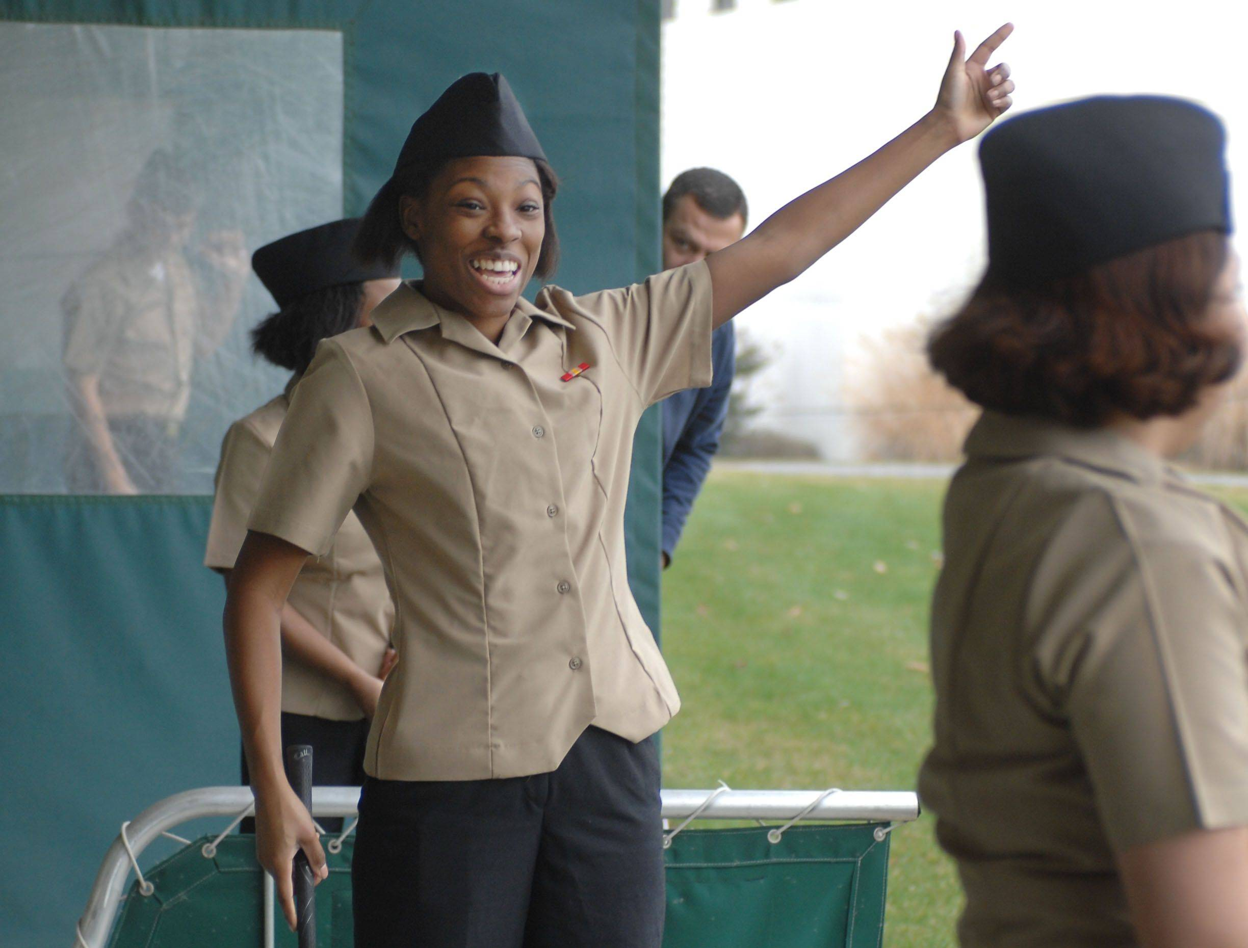 Lake Zurich's New Life Evangelical Lutheran Church participated in the Navy's Adopt-A-Sailor program on Thanksgiving day, bringing twelve recruits to the driving range at the Libertyville Sports Complex. Shawnesha Madison of Las Vegas is thrilled with one of her tee shots Thursday.