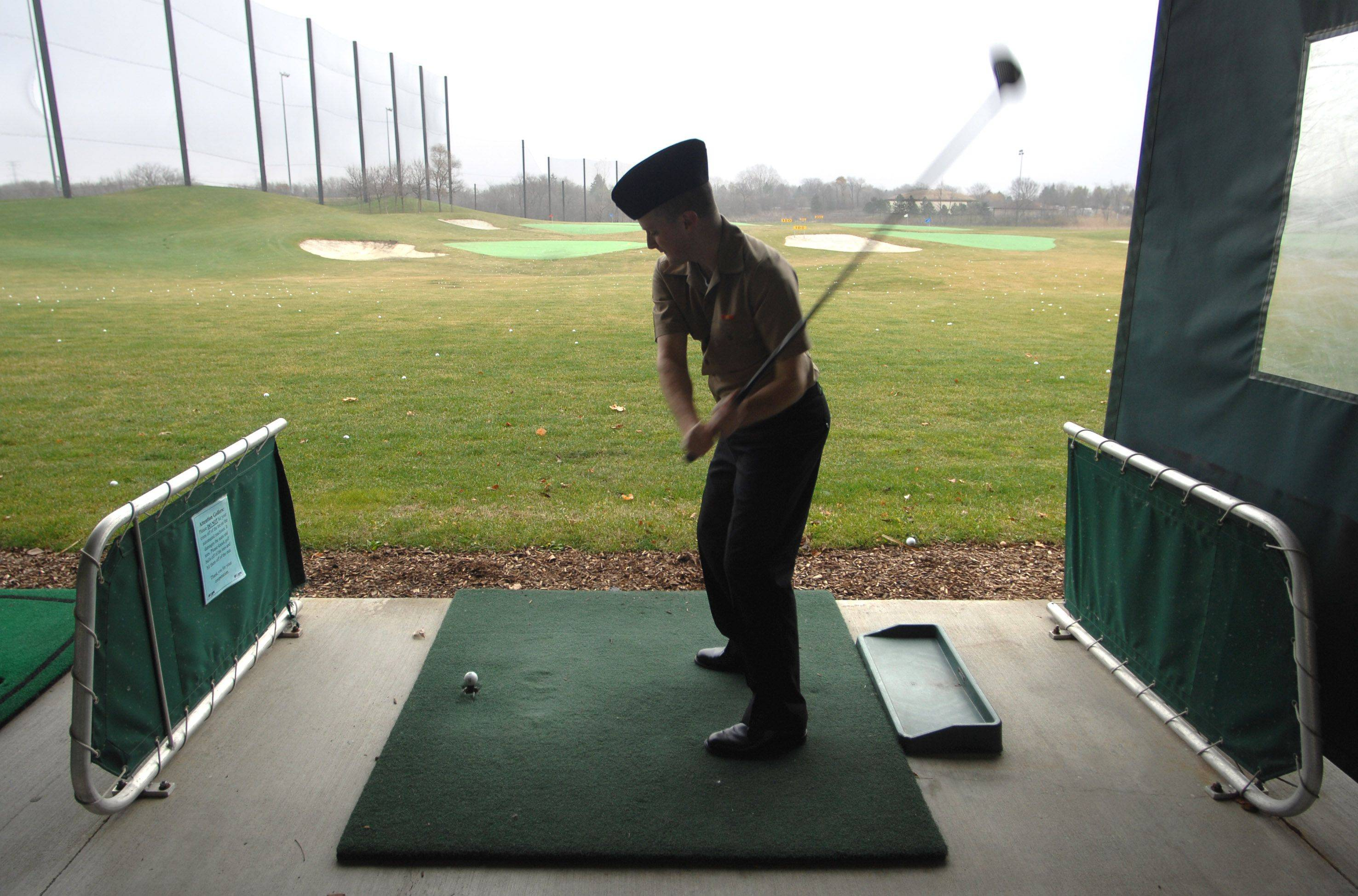 Samuel Harsh of Monroe, North Carolina hits the driving range at the Libertyville Sports Complex Thanksgiving day. He and eleven other Great Lakes recruits were treated to a day of fun compliments of the New Life Evangelical Lutheran Church in Lake Zurich.