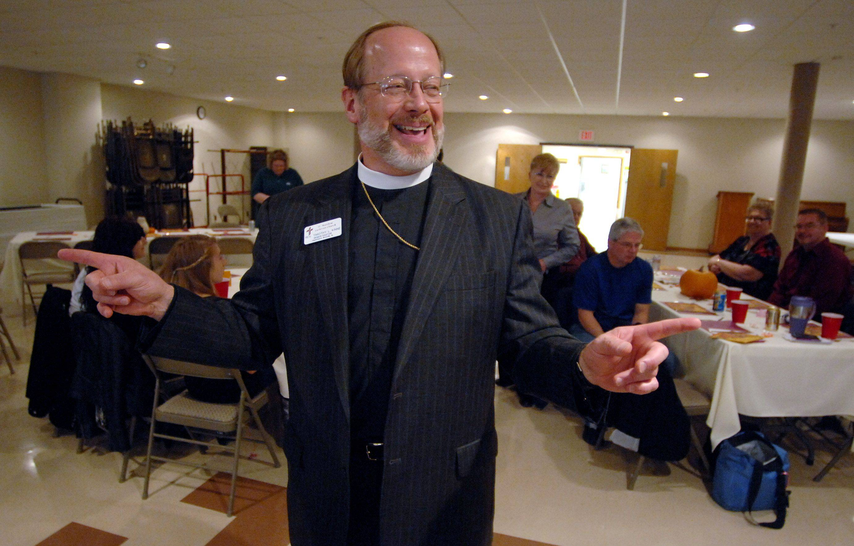 St. Matthew Lutheran Church senior pastor Timothy Kinne offers the blessing and welcomes guests to the Thanksgiving dinner at the Hawthorn Woods church Thursday.