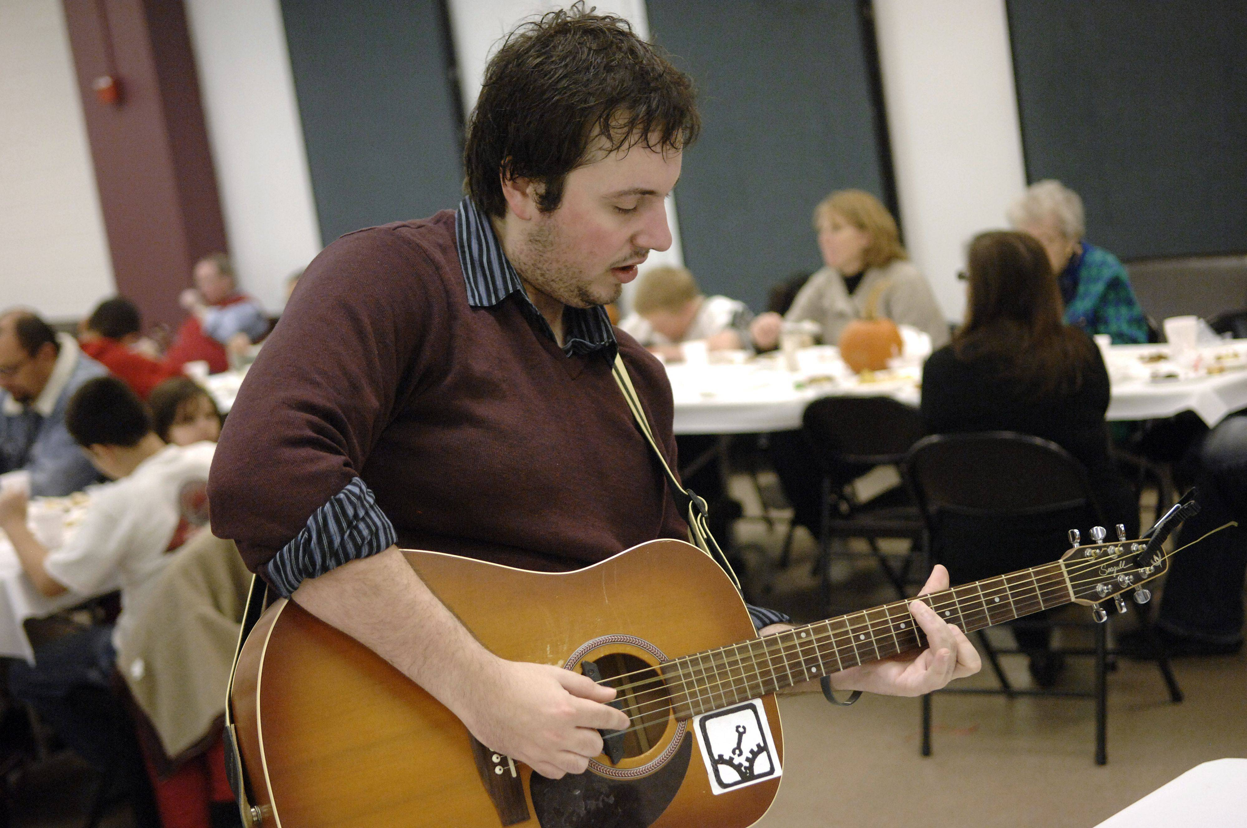 Jesse Greco of Elgin plays requests for diners at the Thanksgiving Community Dinner at the Hemmens Cultural Center in Elgin.