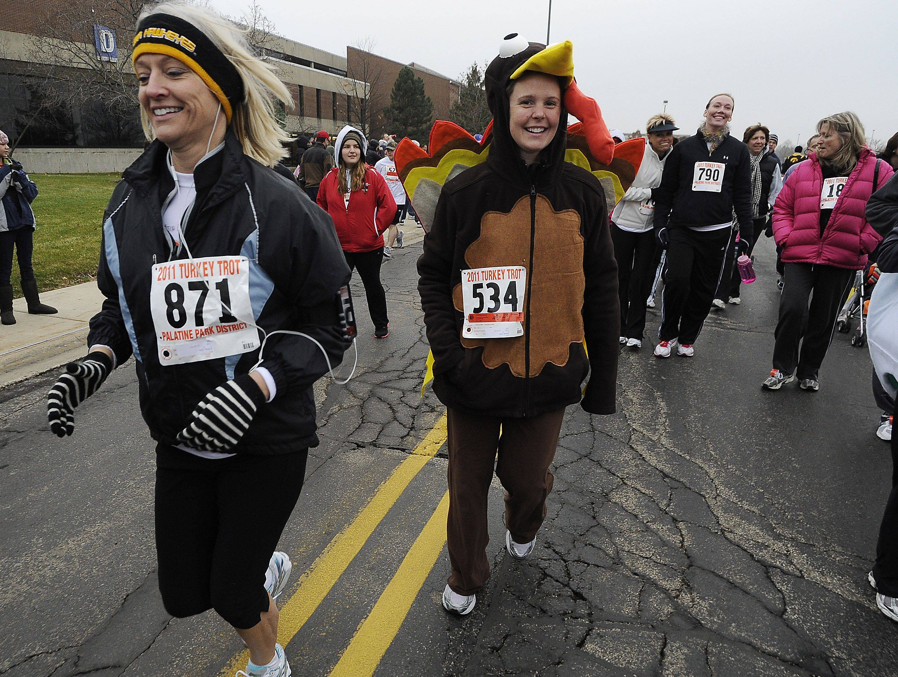 The Palatine Turkey Trot 2-mile run begins at Harper College with hundreds of runners of all ages including Kelly Ksiazek ,31, of Palatine dressed to add a bit of humor to the race.
