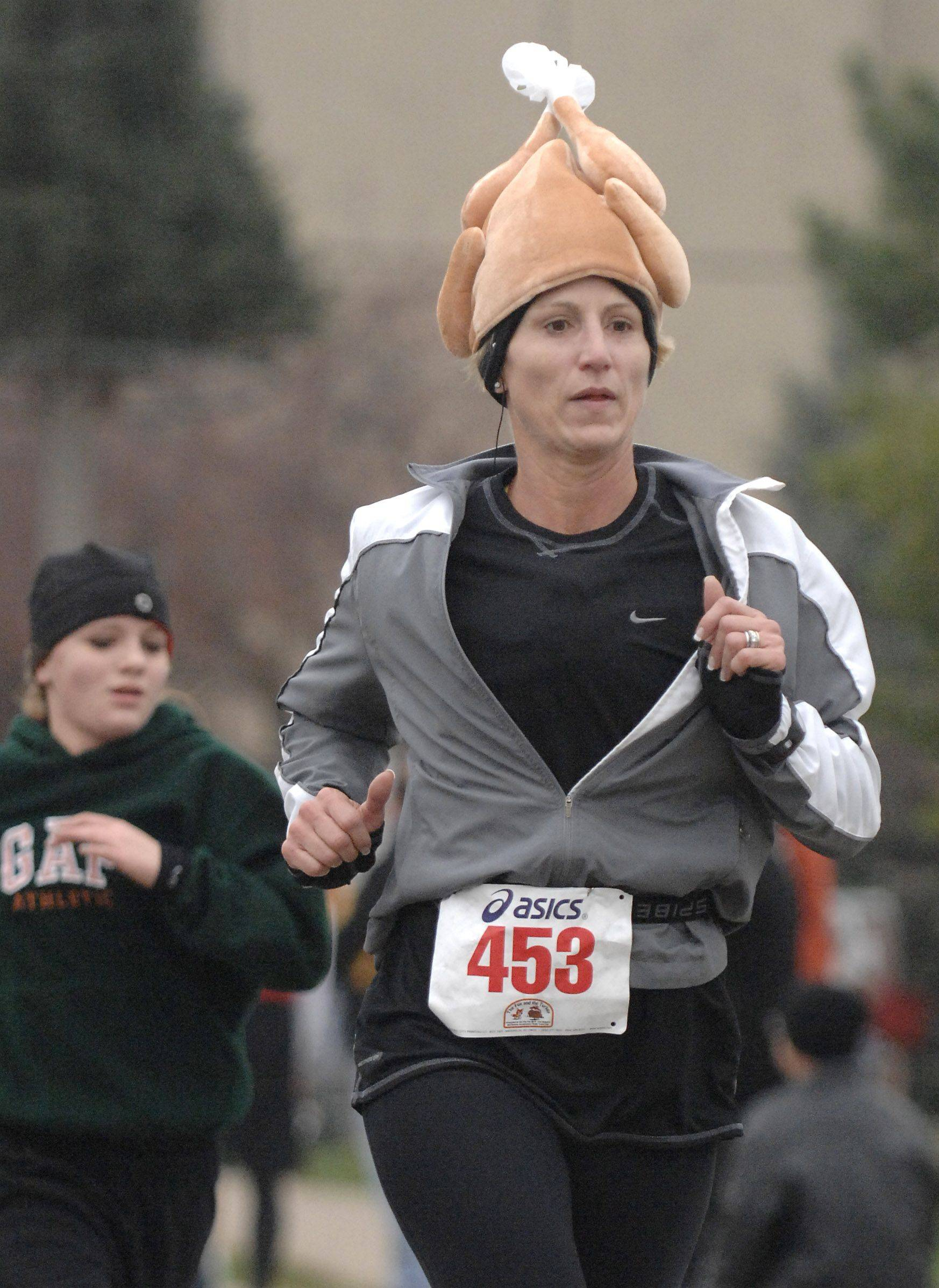 Bethann Bock of South Elgin nears the finish line in the 15th annual Fox and the Turkey four-mile run in Batavia on Thanksgiving morning. Bock ran with her son, Rob, and several other family members visiting from out of town.