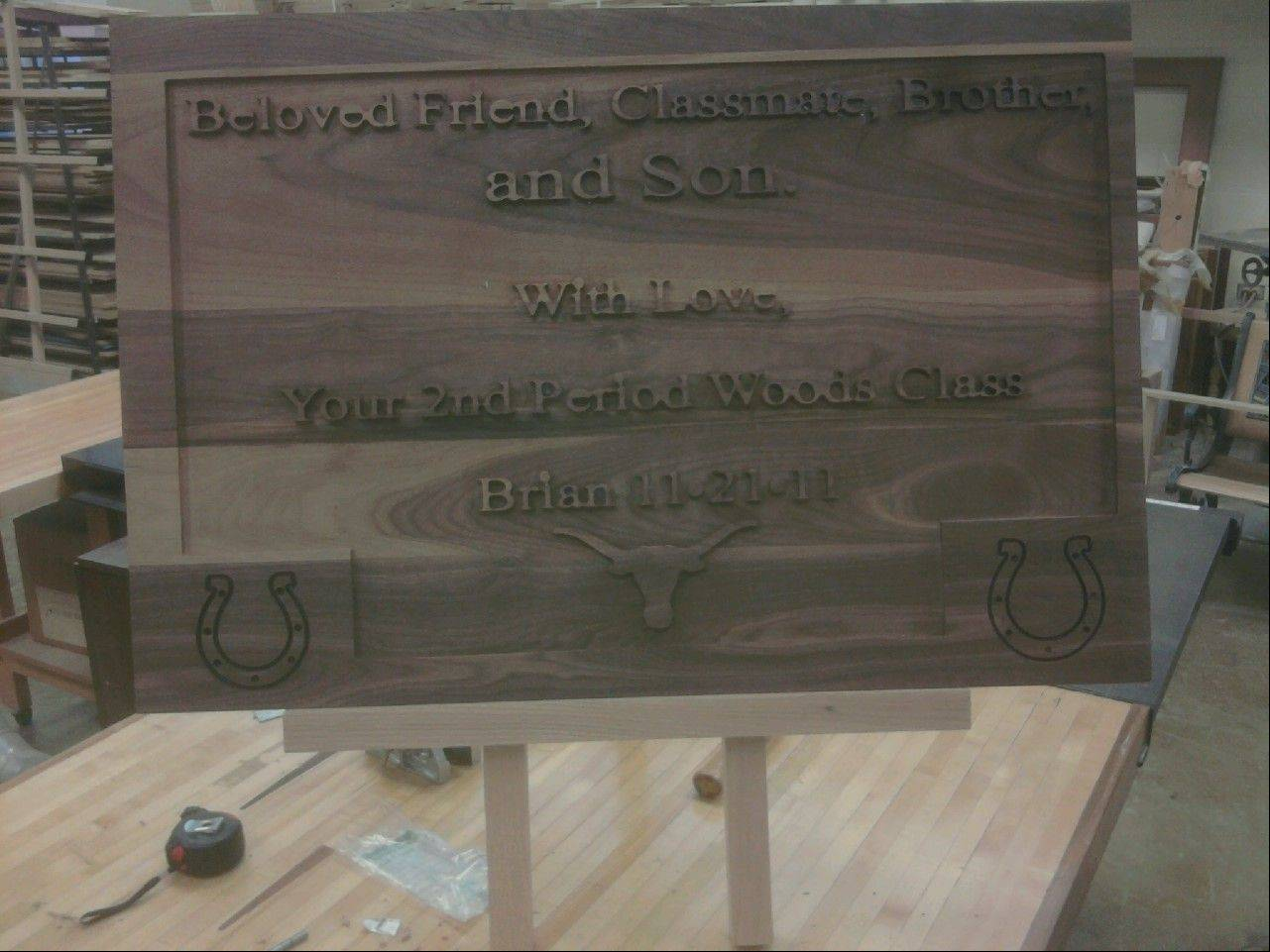 Brian Larsen's woodworking classmates made a walnut engraving to give his family at his wake on Friday, Nov. 25.
