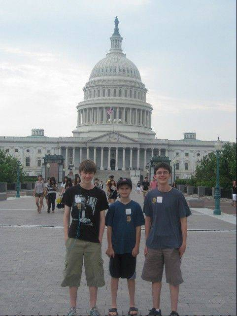 Picking the hottest day of the summer to hike around Washington didn't seem like a capital idea. But, from left, Ross, Will and Ben kept pace from Arlington National Cemetery to the Capitol Building with more smiles than gripes.