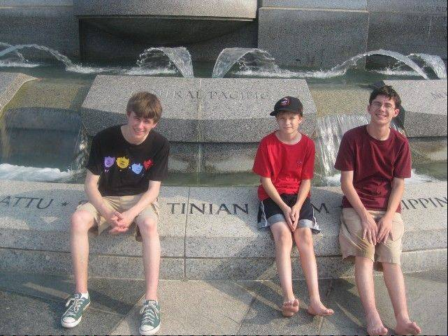 Remembering their Grandpa Willy, who was stationed in Tinian during World War II, made this stop at that war's memorial more memorable for, from left, Ross, Will and Ben.