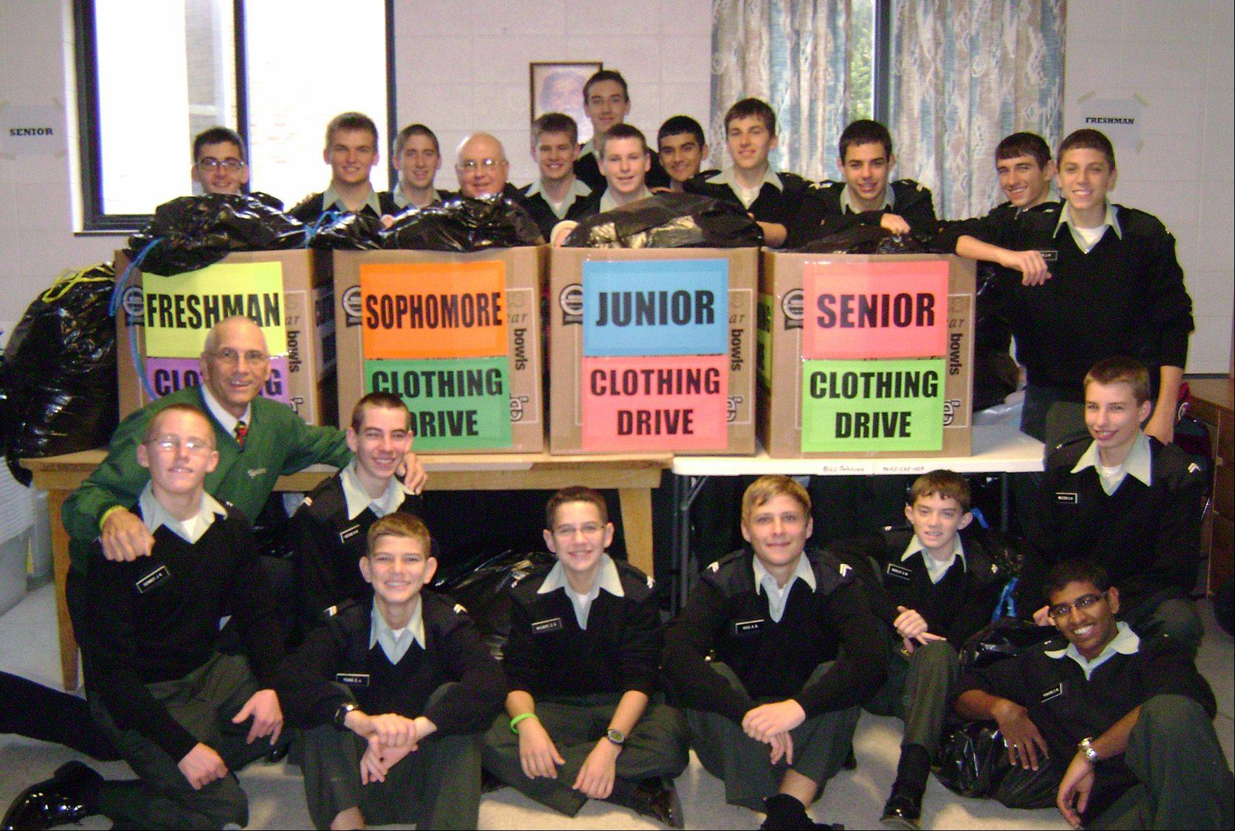 Marmion Academy Campus Ministry Director Bill Johnson, Student Chaplain the Rev. Michael Burrows and Marmion students are grateful for the success of their Winter Clothing Drive, which collected more than 3,000 of clothing for needy residents.