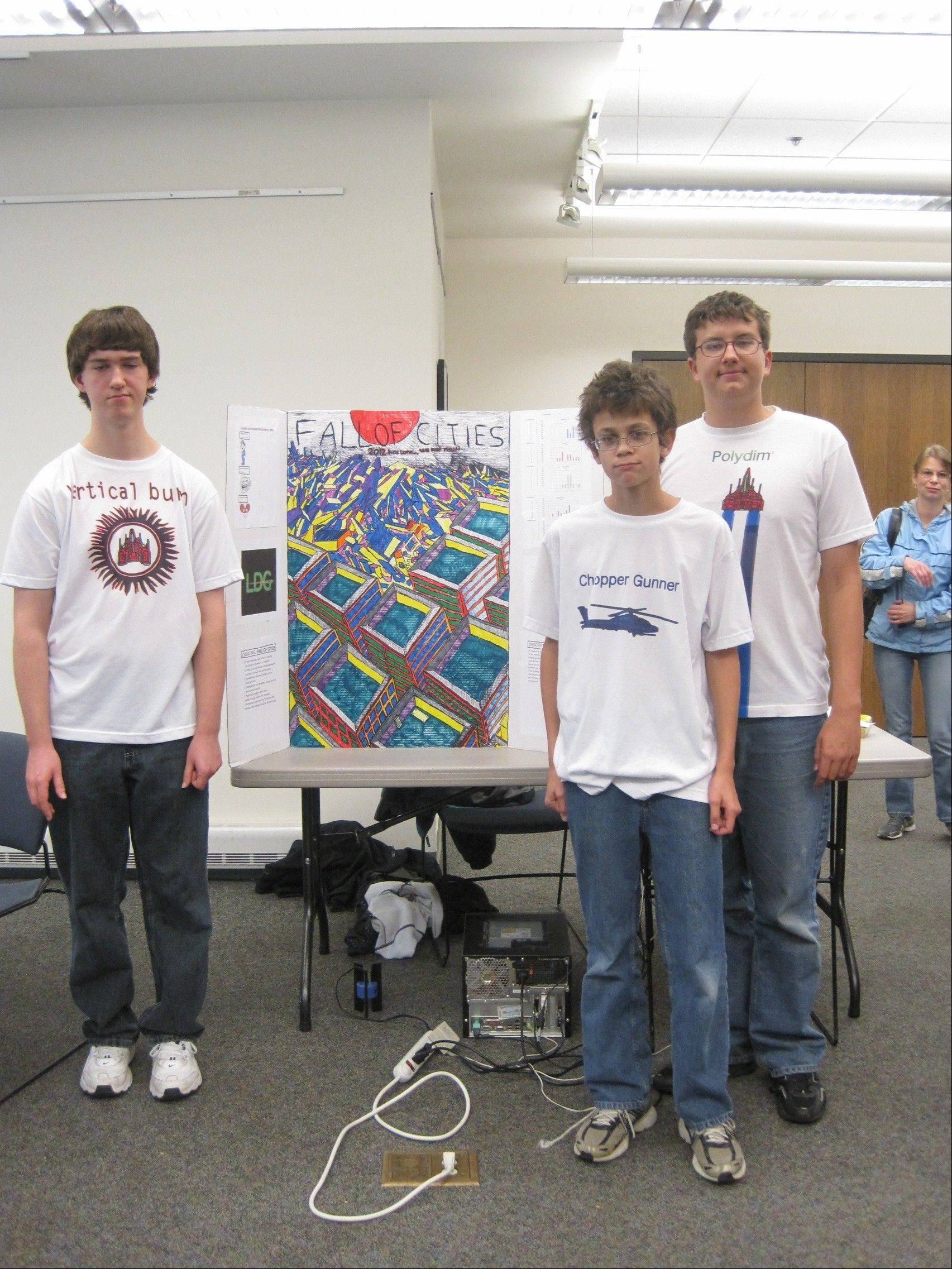 "Winner of the Indian Trails Public Library's 2011 Operation Game Creation competition was the team ""Loading Data Games."" Team members, from left, are Brendan Liokumovich, Sergey Papushin and Dmitry Lahucik. Their game, ""Fall of Cities,"" beat out six other teams that submitted five board games and a computer game."