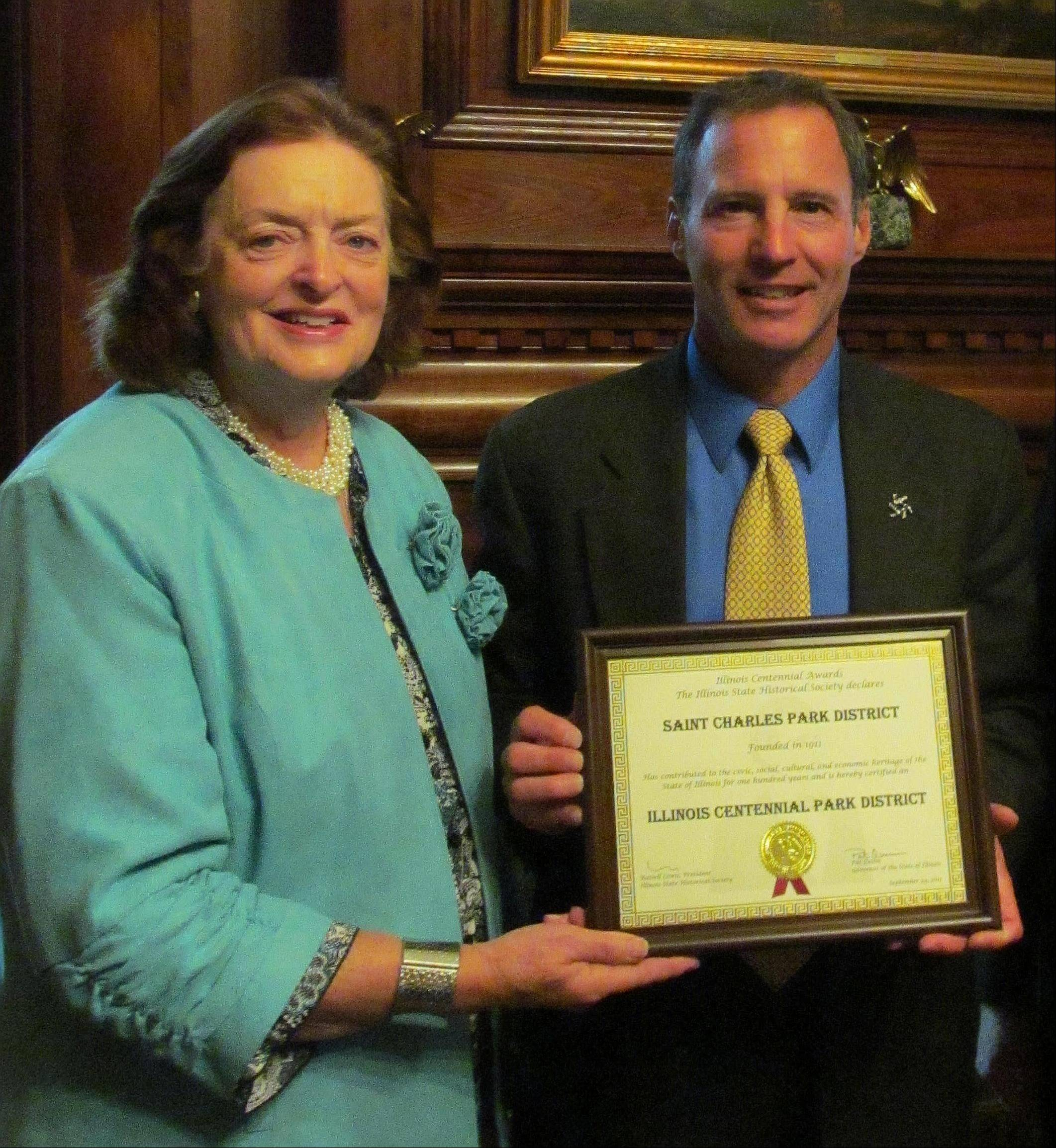 Illinois State Historical Society representative Connie Speck presents St. Charles Park District Executive Director Ray Ochromowicz with a centennial award.