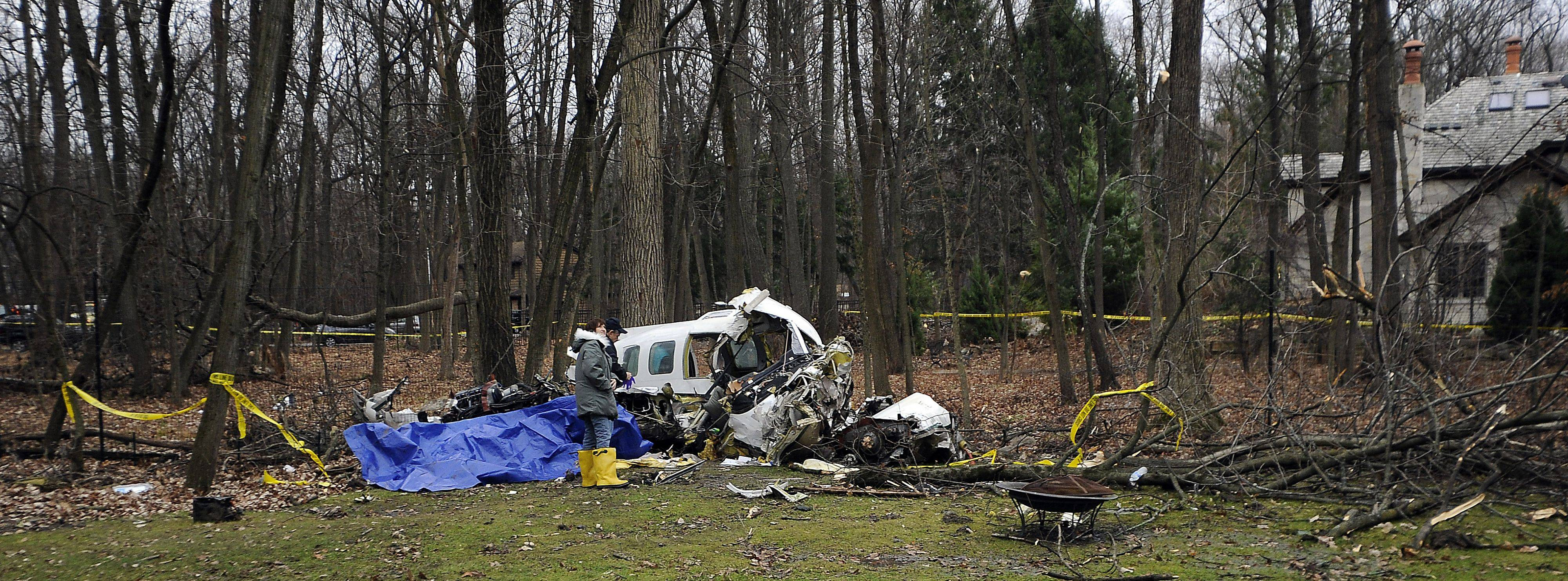 A twin-engine plane crashed Monday night between two houses in Riverwoods. No one on the ground was injured but three people on the plane were killed and two others were injured.