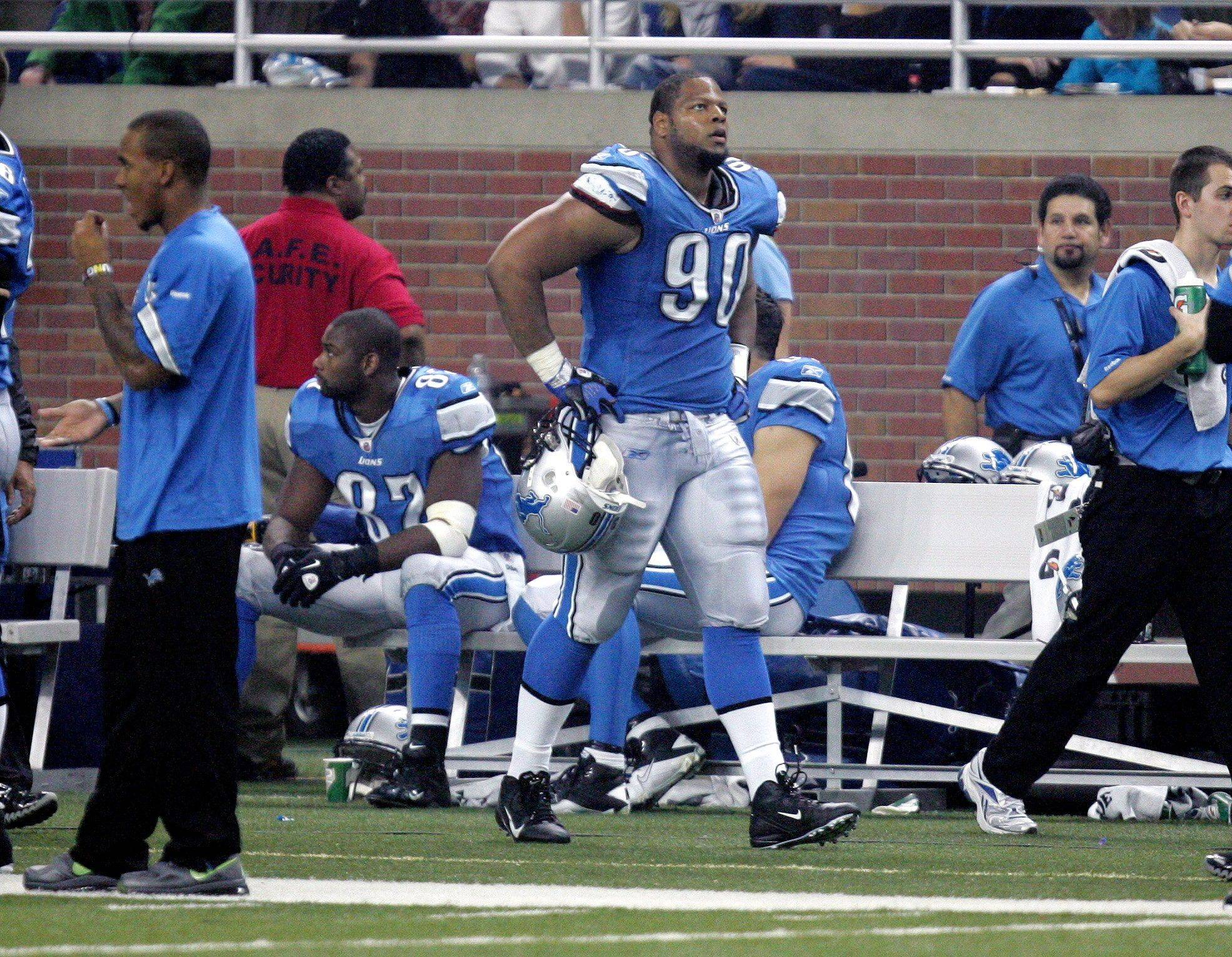 Detroit Lions defensive tackle Ndamukong Suh (90) on the sidelines after being ejected for an incident in the third quarter in Thursday's game against the Green Bay Packers in Detroit.