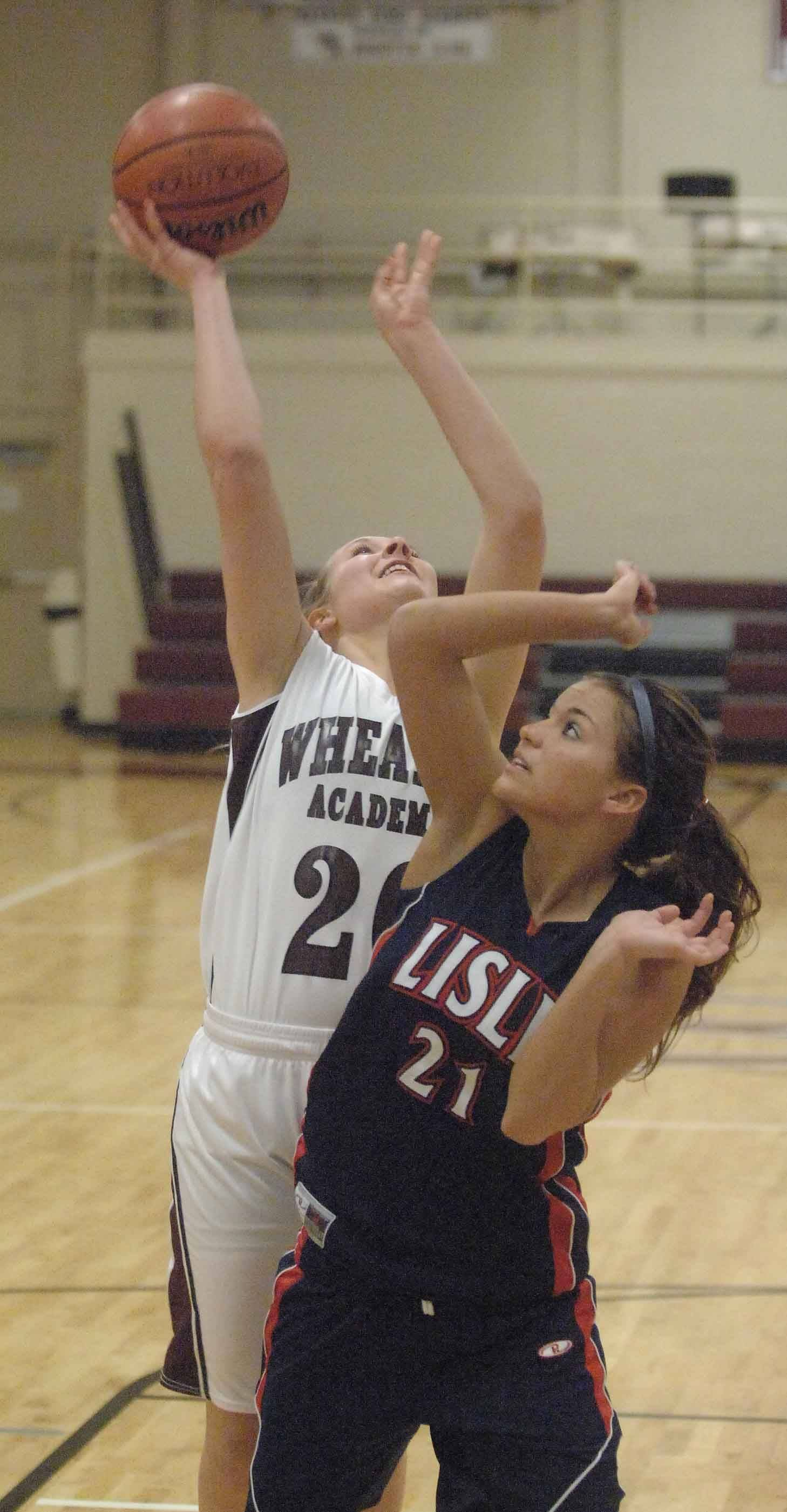 Sarah Drury of Wheaton Academy, left, and Kelly Urban of Lisle, during game action Tuesday.