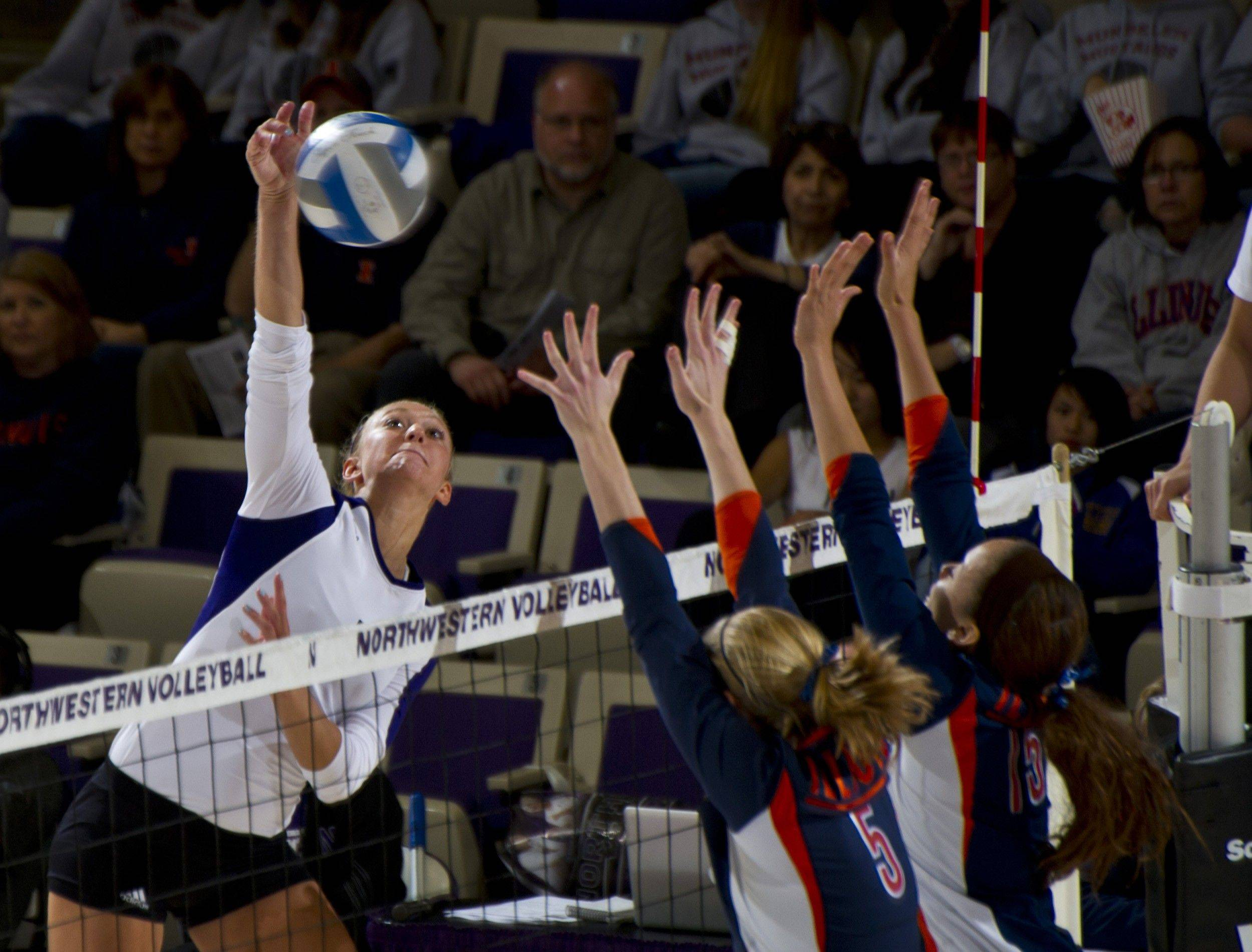 Stephanie Holthus, a Northwestern outside hitter, slams home a shot against the Illini in a match this fall. Holthus, a sophomore who played at Burlington Central, earned a spot on the All Big Ten Volleyball Team, which was announced Tuesday.