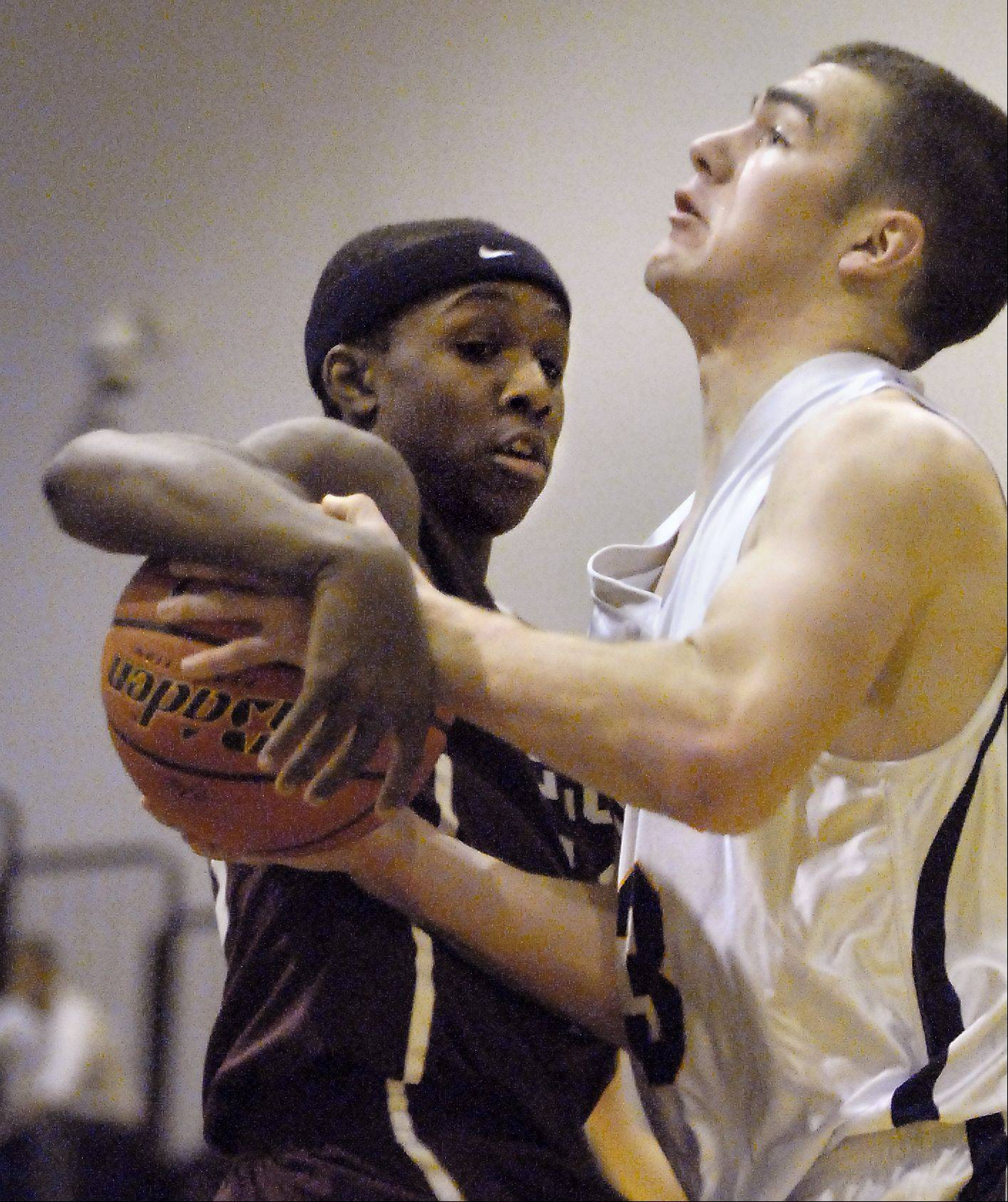 Elgin's Arie Williams, 10, fouls Buffalo Grove's Ryan Inlow,33, as he drives to the basket at the Bison Classic 2011 Monday in Buffalo Grove.