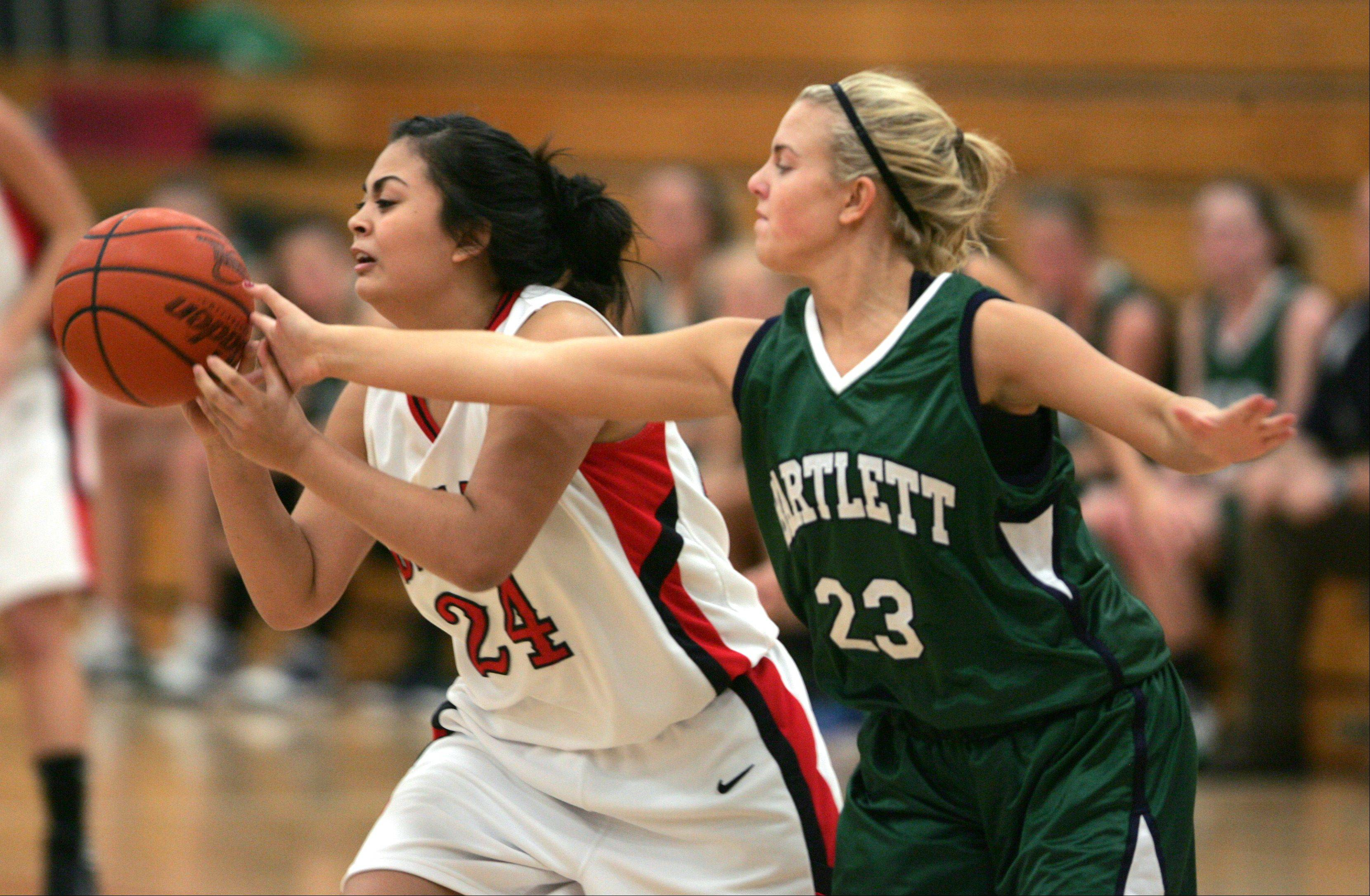 Benet's Eden Olson, left, battles Bartlett's Ashley Johnson during Friday's 2011 Tip-Off Tournament basketball game in Lisle.