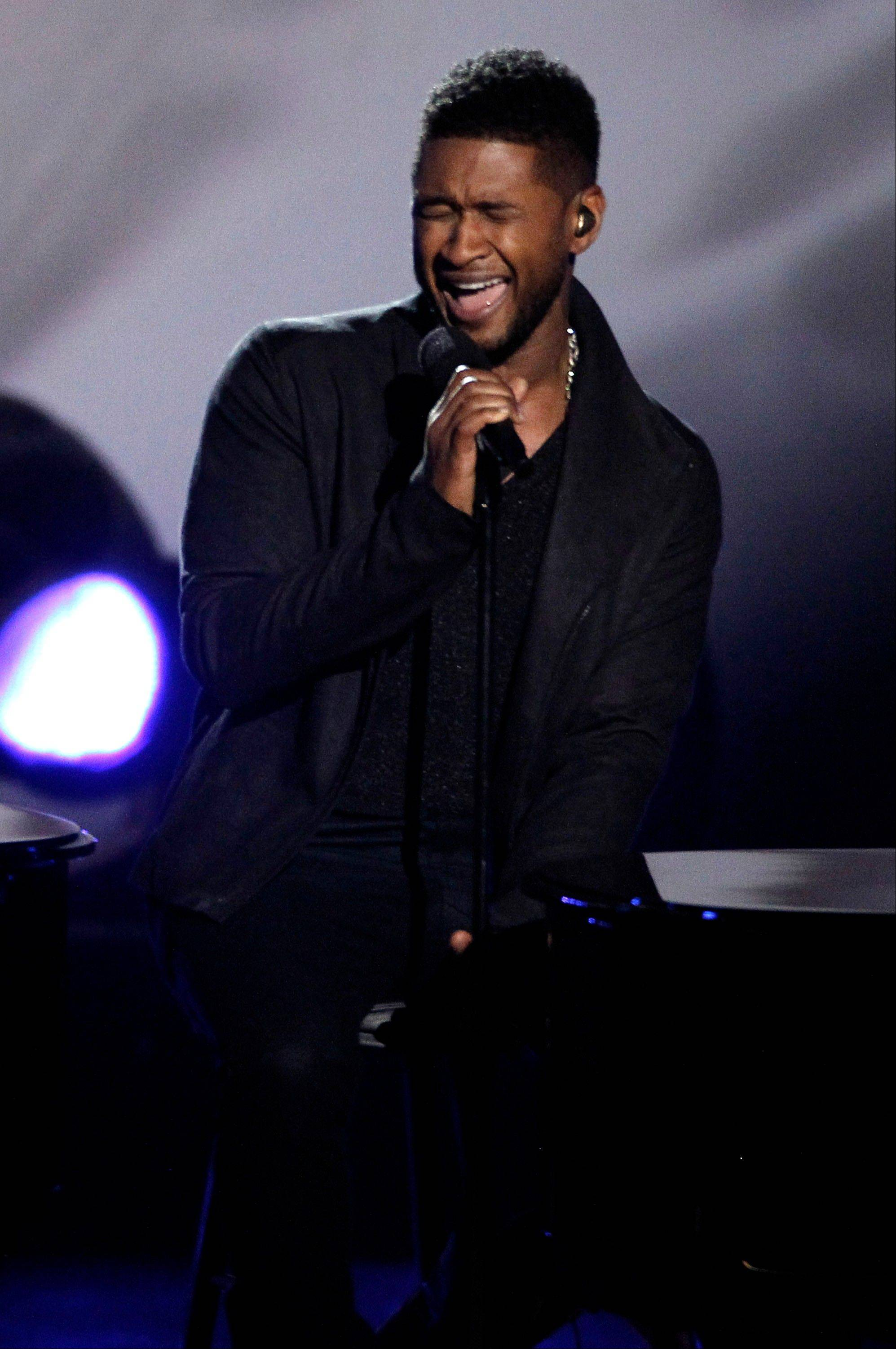 Usher performs Wednesday at the Grammy Nominations Concert in Los Angeles.