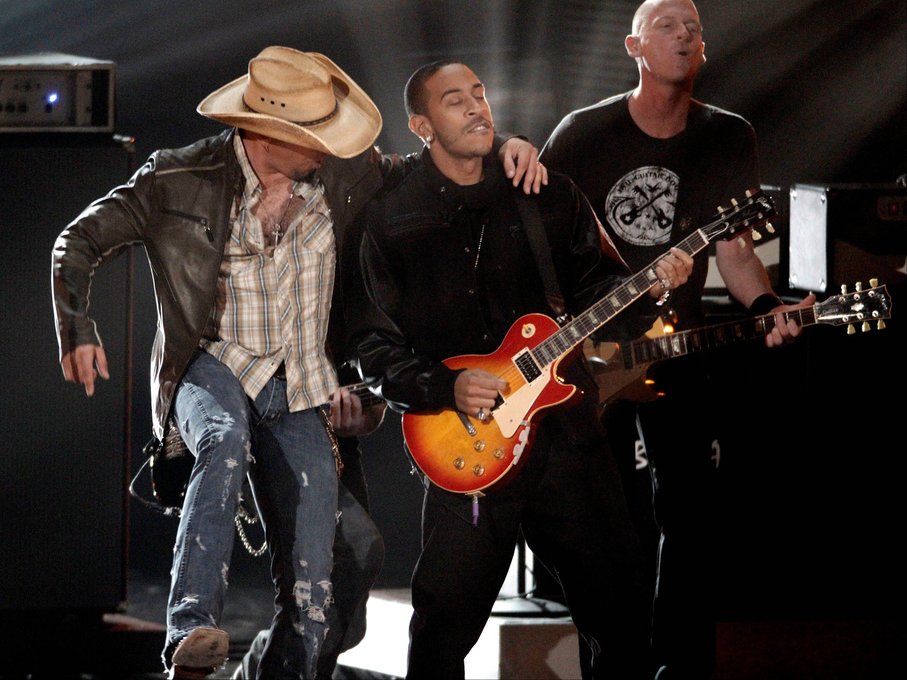 Jason Aldean, left, and Ludacris perform Wednesday at the Grammy Nominations Concert in Los Angeles.