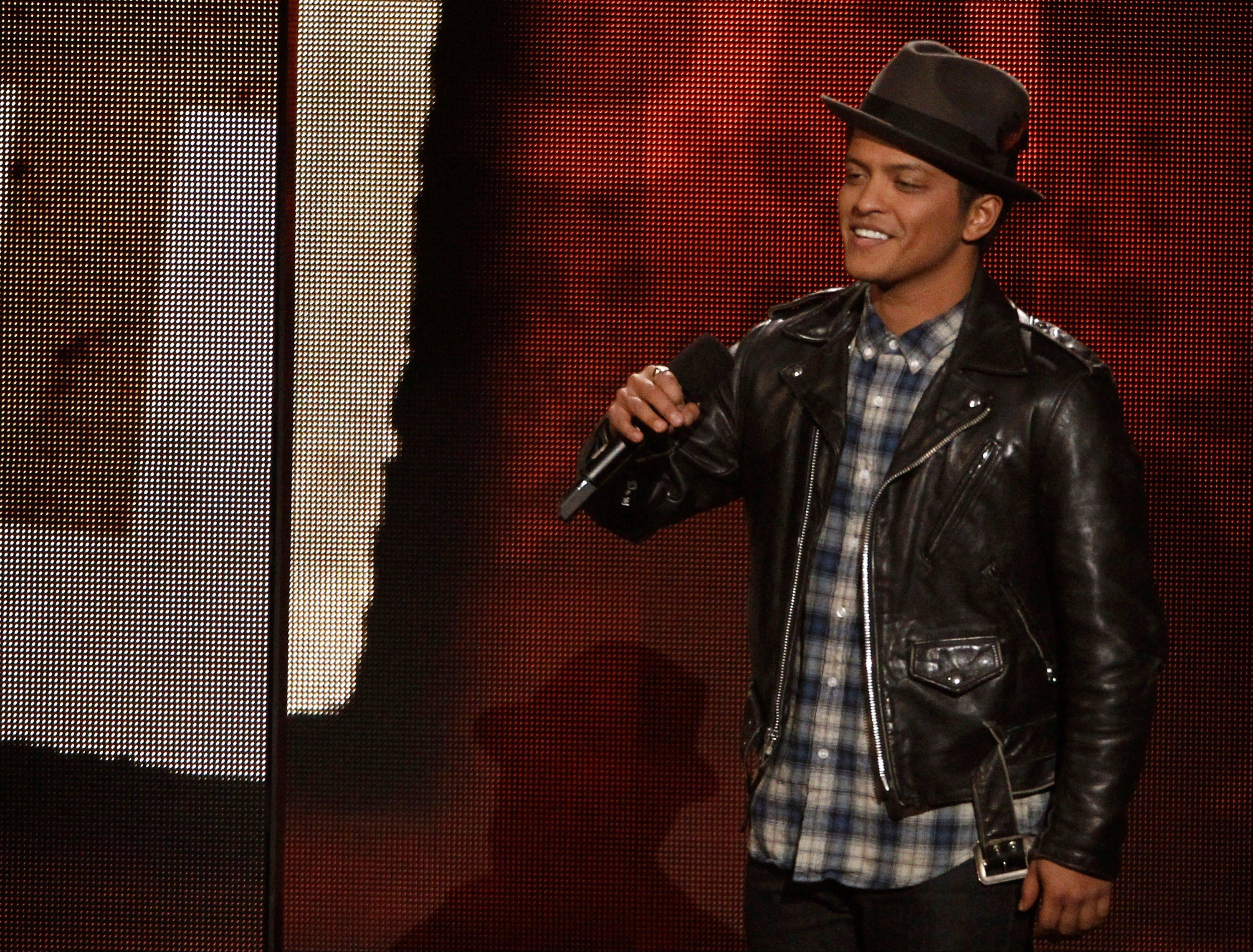 Bruno Mars announces the nominees for best new artist Wednesday at the Grammy Nominations Concert in Los Angeles.