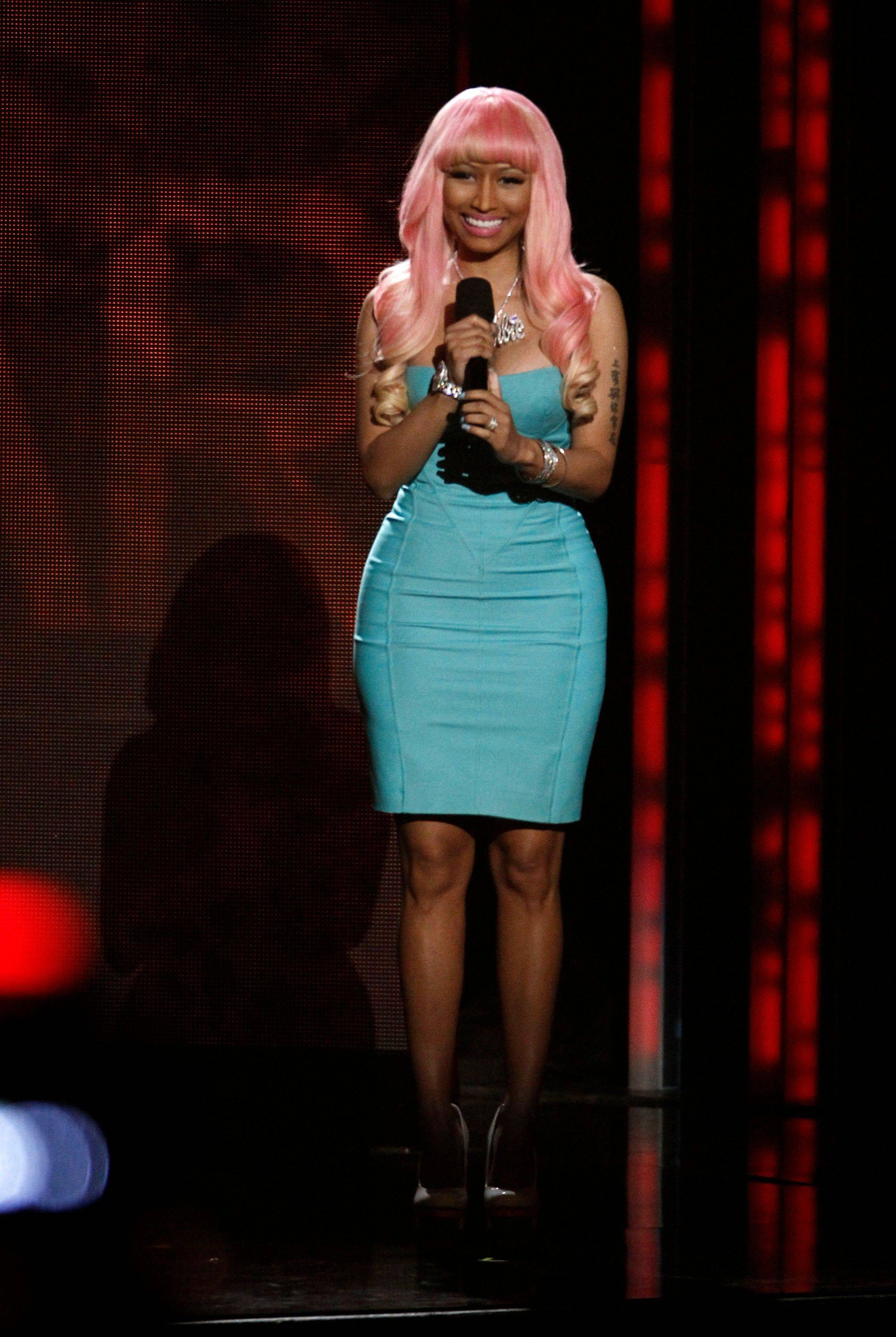 Nicki Minaj announces the nominees for record of the year Wednesday at the Grammy Nominations Concert in Los Angeles.