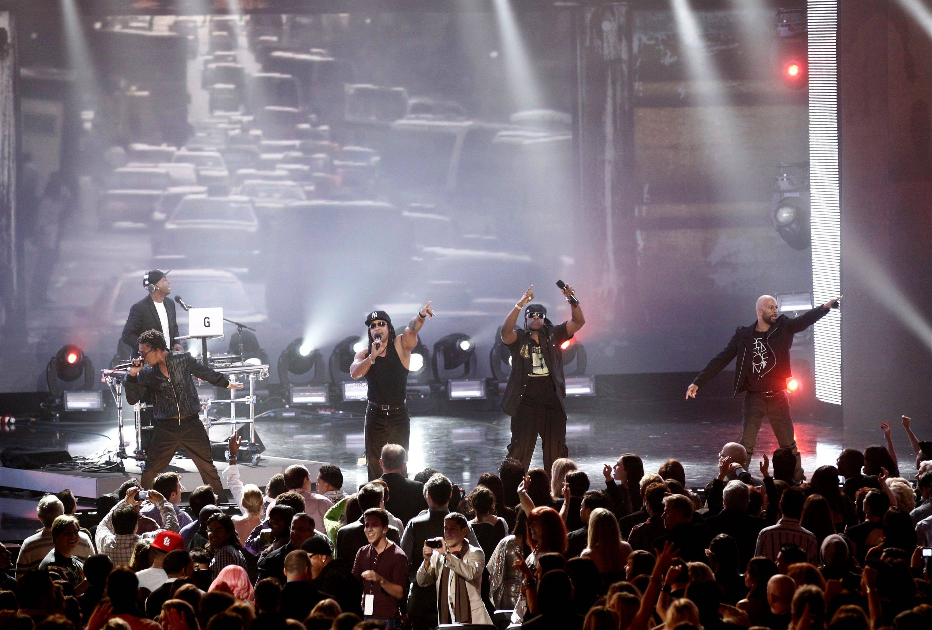 From left, Lupe Fiasco, Melle Mel, Scorpio, Common and Grandmaster Flash, in background, perform Wednesday at the Grammy Nominations Concert in Los Angeles.