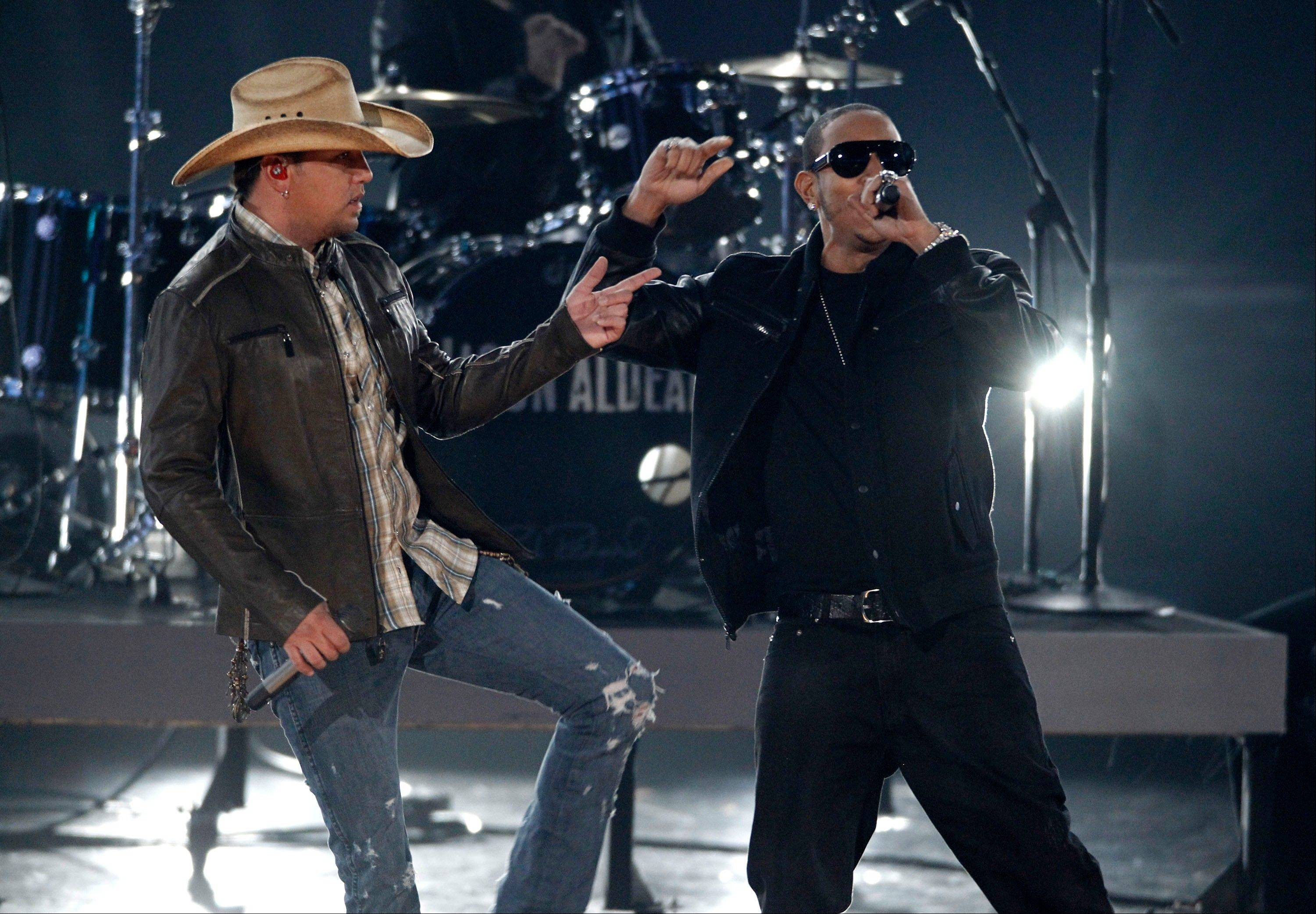 Jason Aldean, left, and Ludacris perform Wednesday at the Grammy Nominations Concert in Los Angeles. (