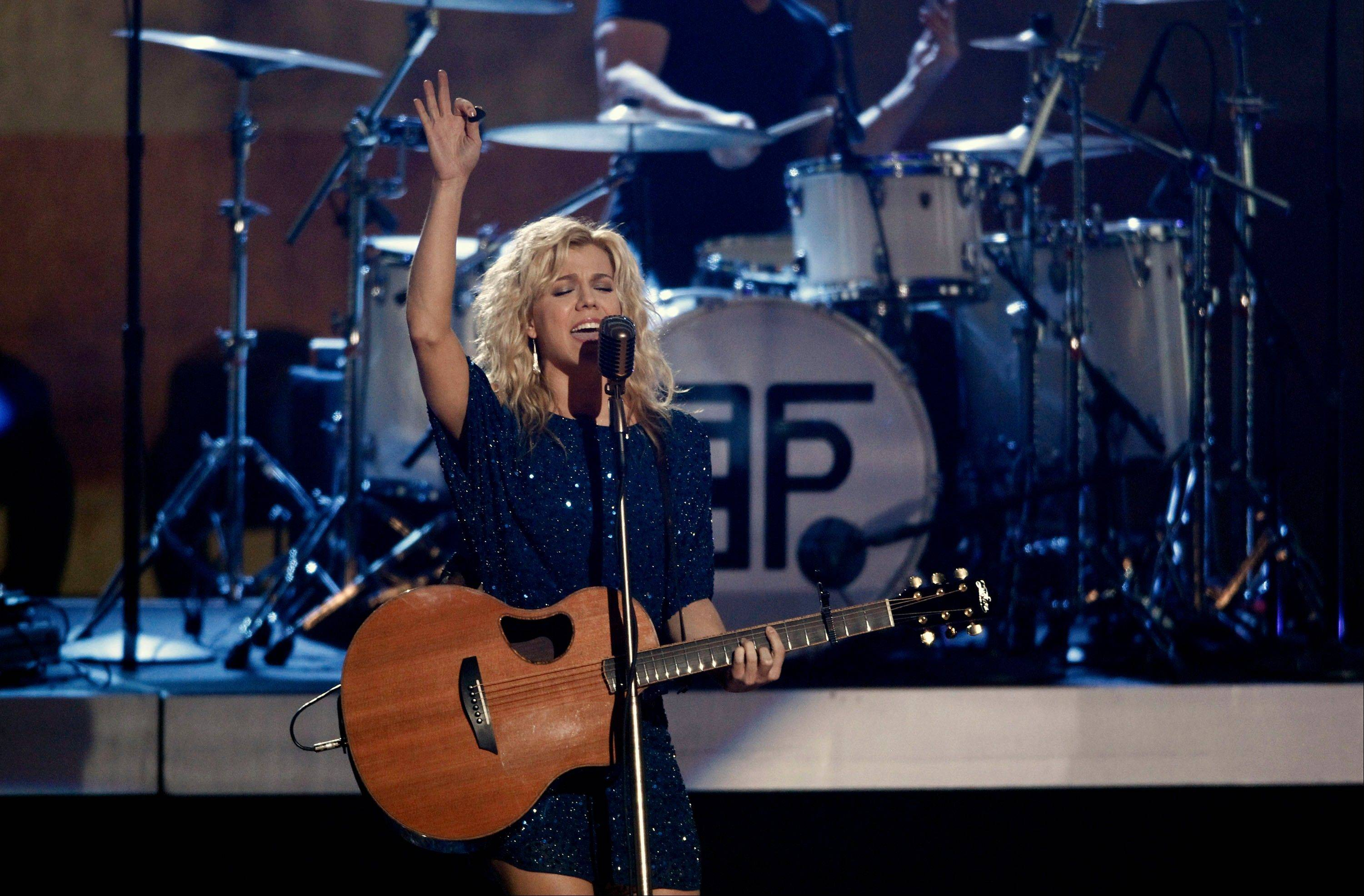 Kimberly Perry, of The Band Perry, performs Wednesday at the Grammy Nominations Concert in Los Angeles.
