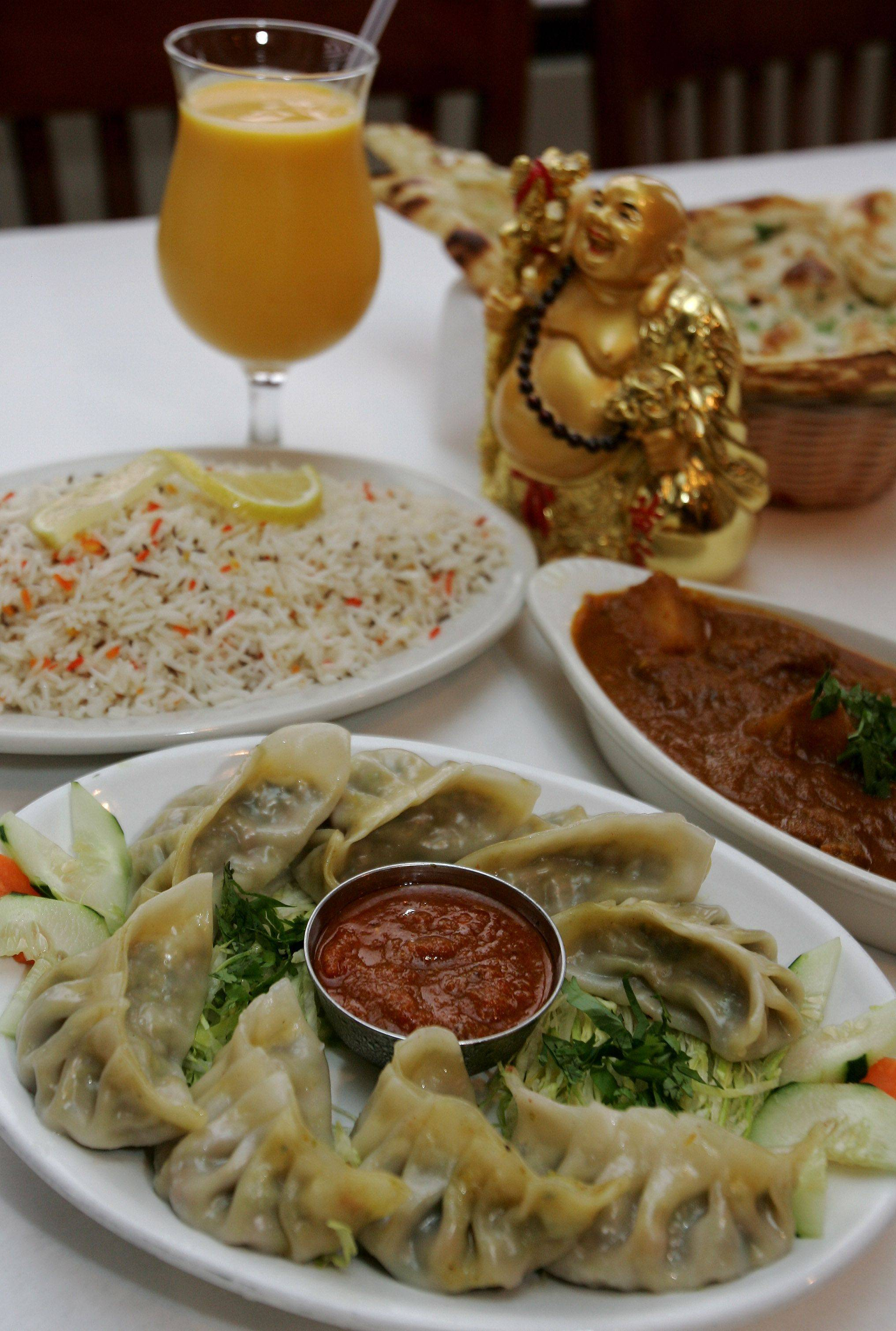 Vegetable momo, front, lamb vindaloo, right, garlic naan and jeera rice are just a few of the dishes offered at Gurnee's Himalayan Restaurant.