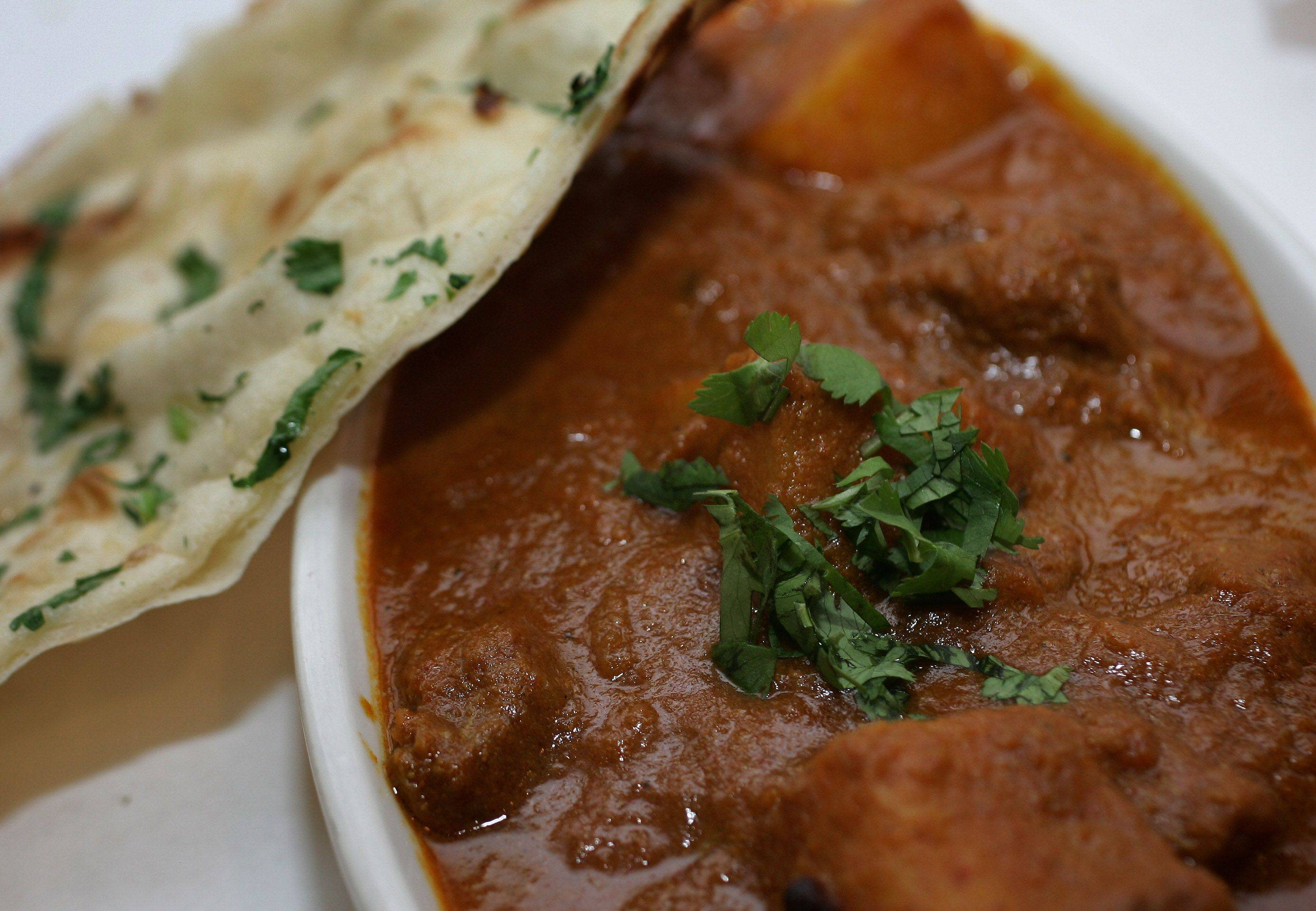 Lamb vindaloo, which is lamb in a Goan-style hot curry sauce, comes with a side of garlic naan at the Himalayan Restaurant in Gurnee.