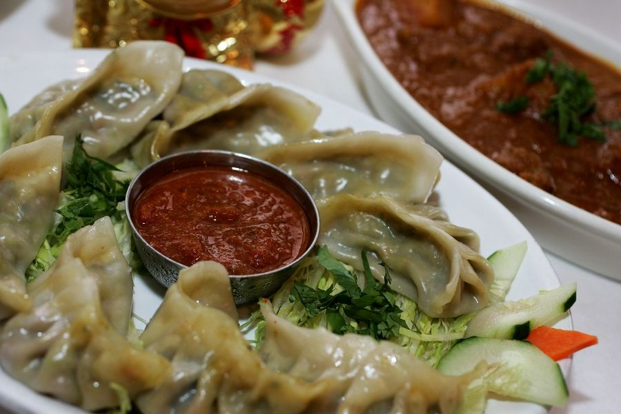 The Himalayan Restaurant serves up vegetable momo, left, and chicken makhani.