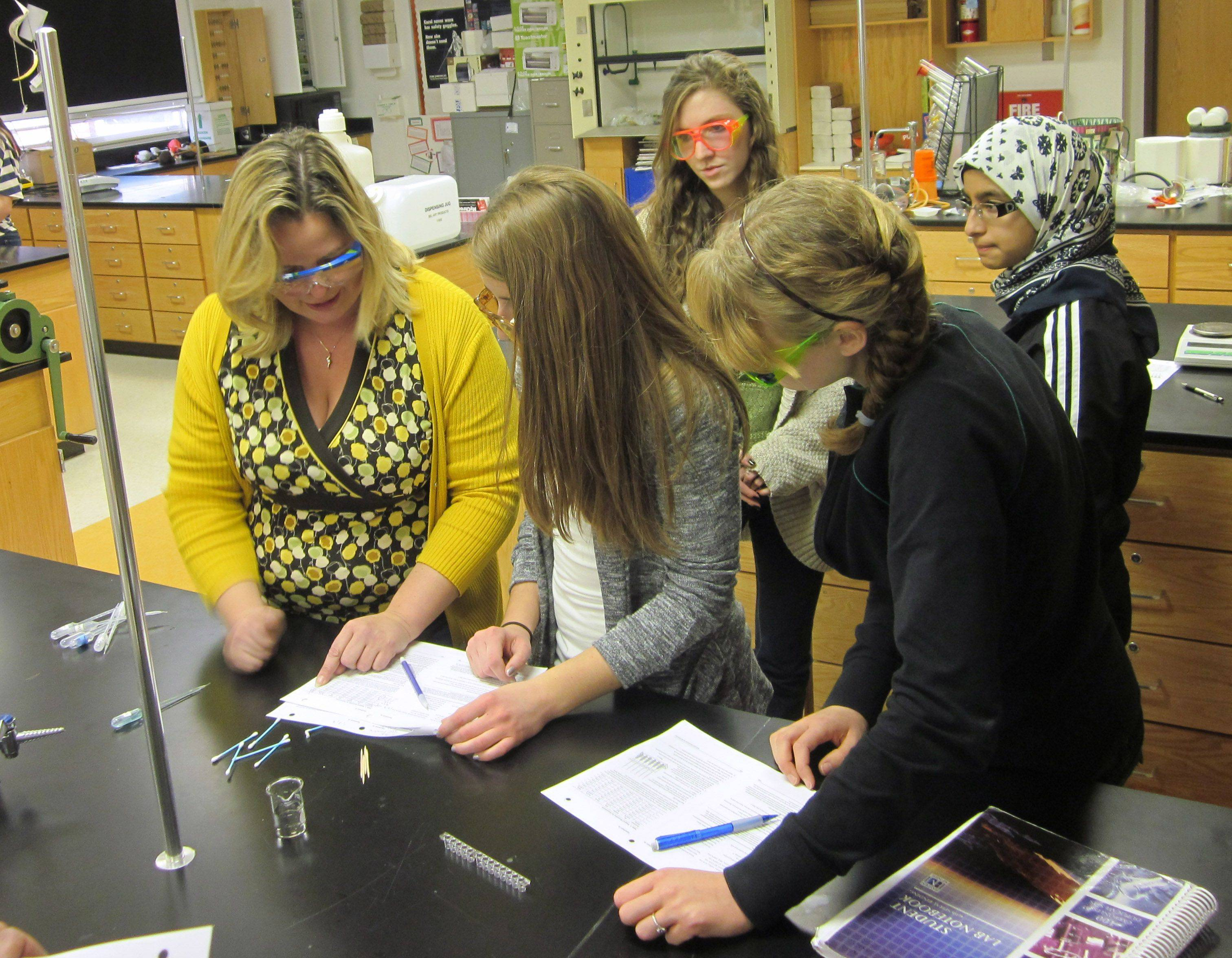 Libertyville High School chemistry teacher Sherri Rukes, left, works with students Kathleen Morris, Jessica White, Stephanie Hanagan and Aasimah Tanveer on Thursday. Rukes will receive grants to pursue three innovative programs.