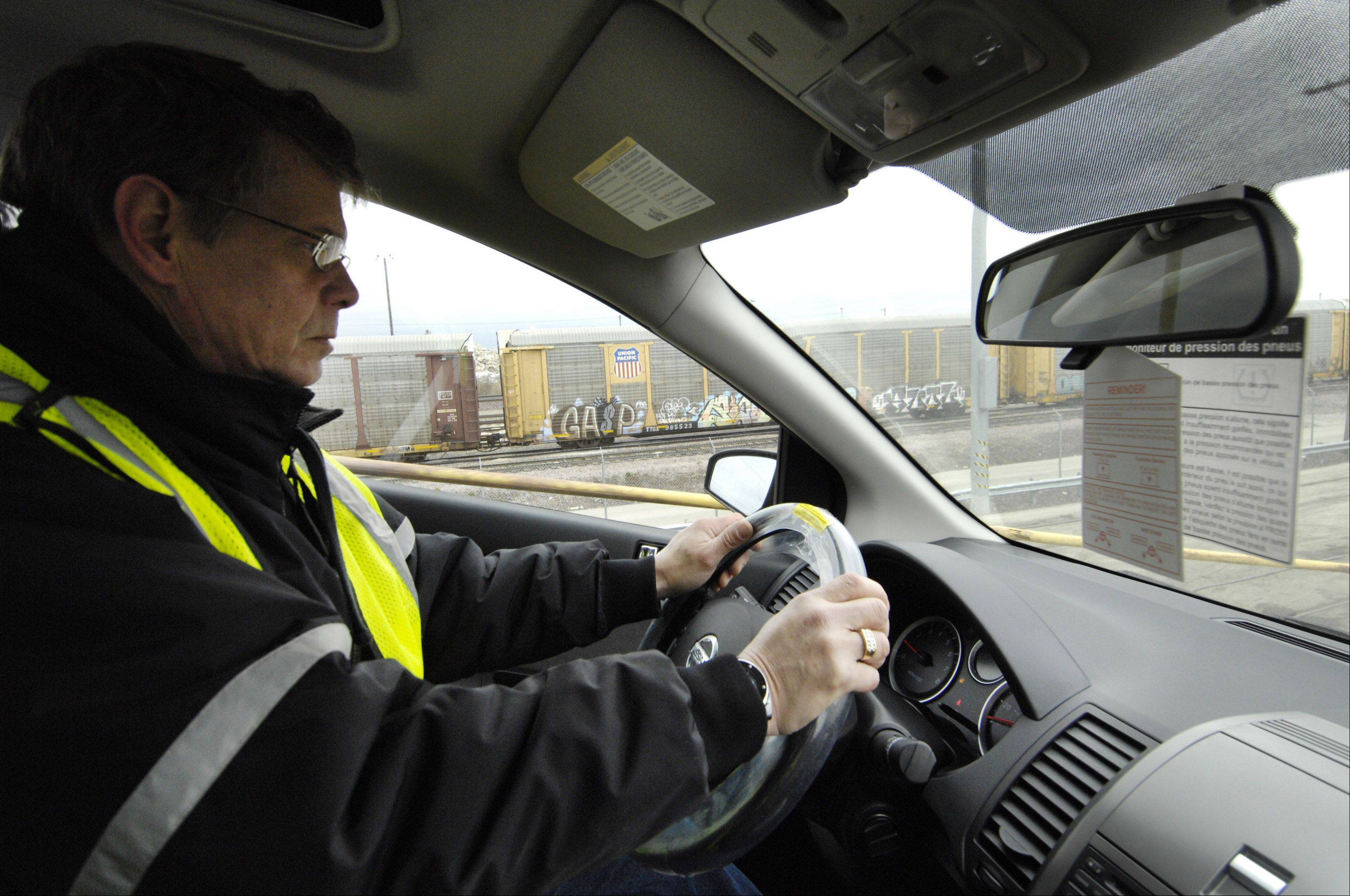 Facility Ramp Manager Robert Holmes drives a car out of a tri-level rail car at the Union Pacific Auto Facility in West Chicago.