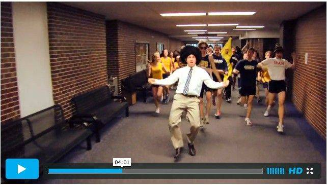 "In the middle of Glenbrook South's 50th-anniversary ""Lip Dub"" video, a wigged dancer leads spirited classmates down the hallway."