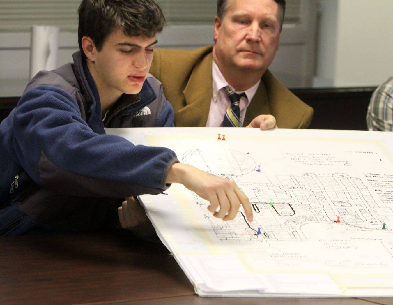 Troy Farsakian, a senior at Glenbrook South High School, shows the planning board used to produced the school's 50th-anniversary video.