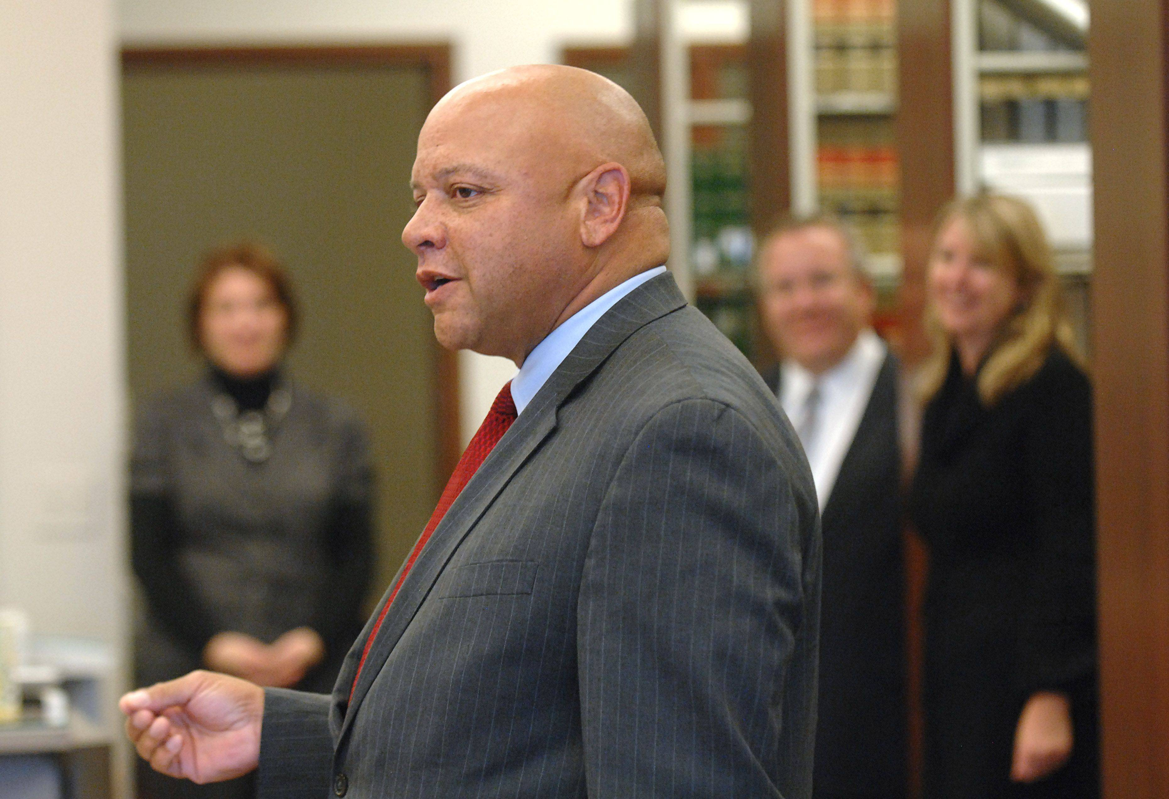 "Kane County Chief Judge F. Keith Brown gives a speech last year at the open house for the ""Lawyer in the Library"" program inside the Kane County Law Library and Self Help Legal Center during National Pro Bono Week."
