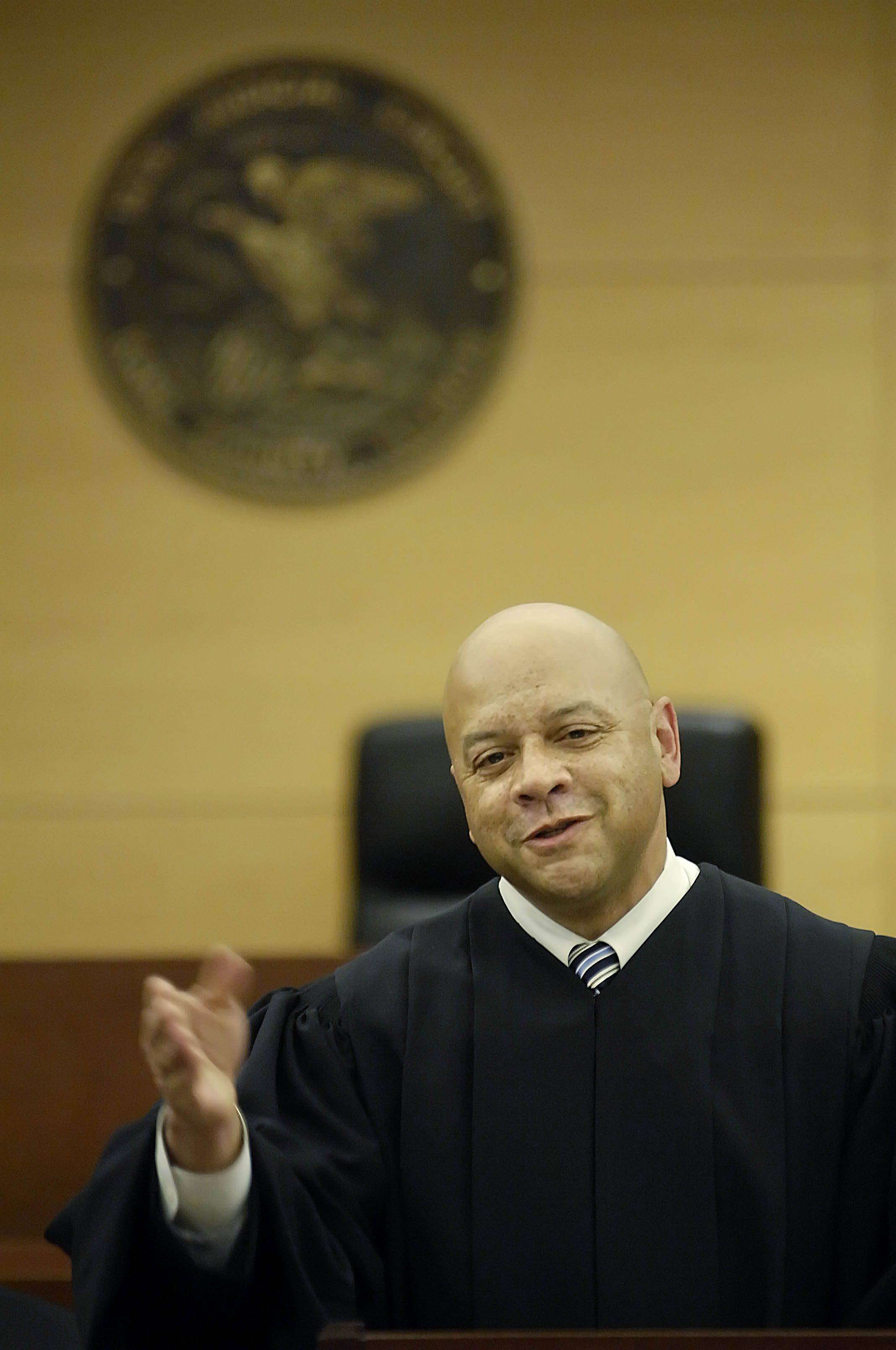 F. Keith Brown speaks after being sworn in three years ago as Kane County's chief judge.
