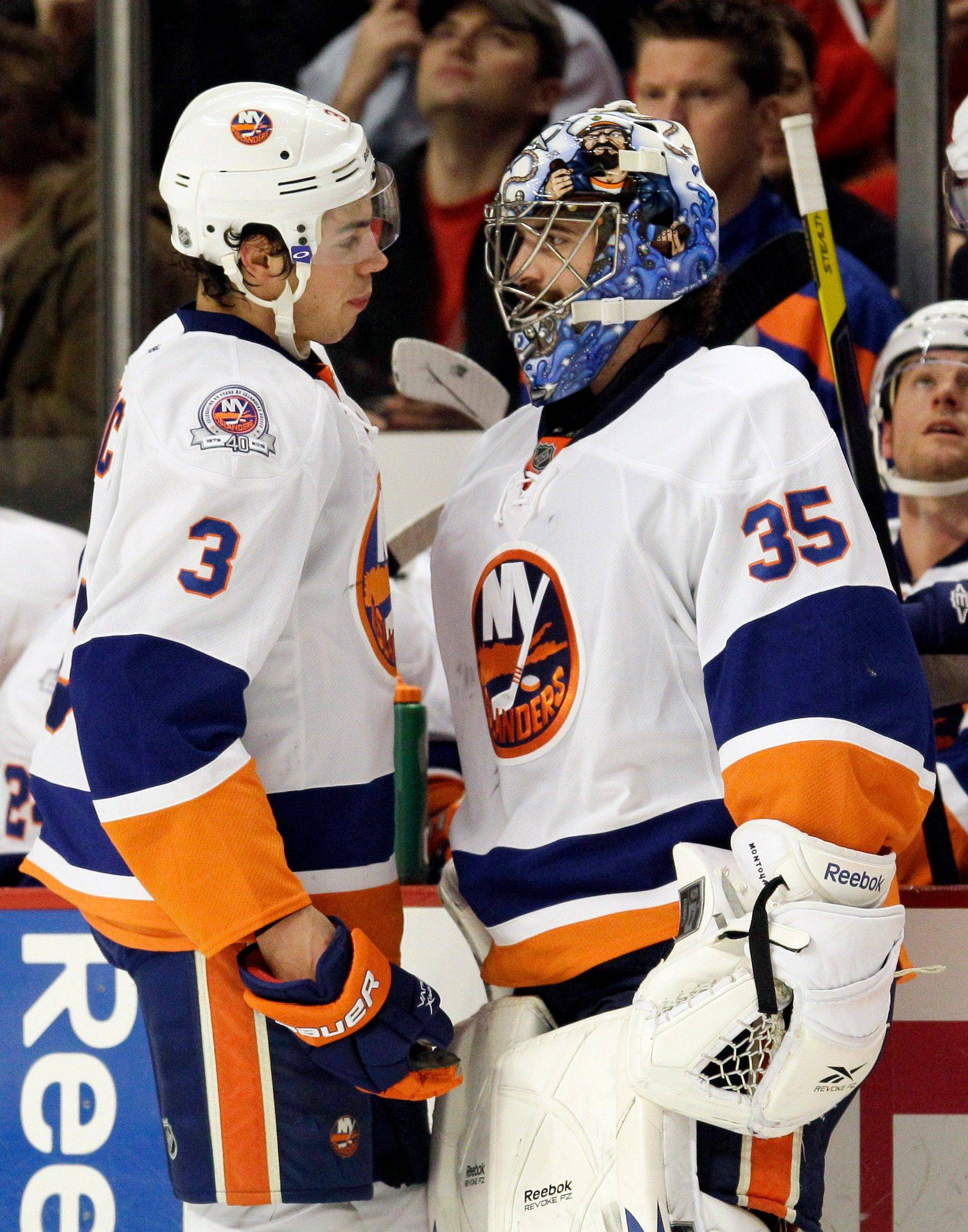 Associated PressTravis Hamonic talks with goalie Al Montoya during the first period of the Islanders' game with the Blackhawks on Friday. Montoya is from Glenview and was the sixth pick in the 2004 draft.