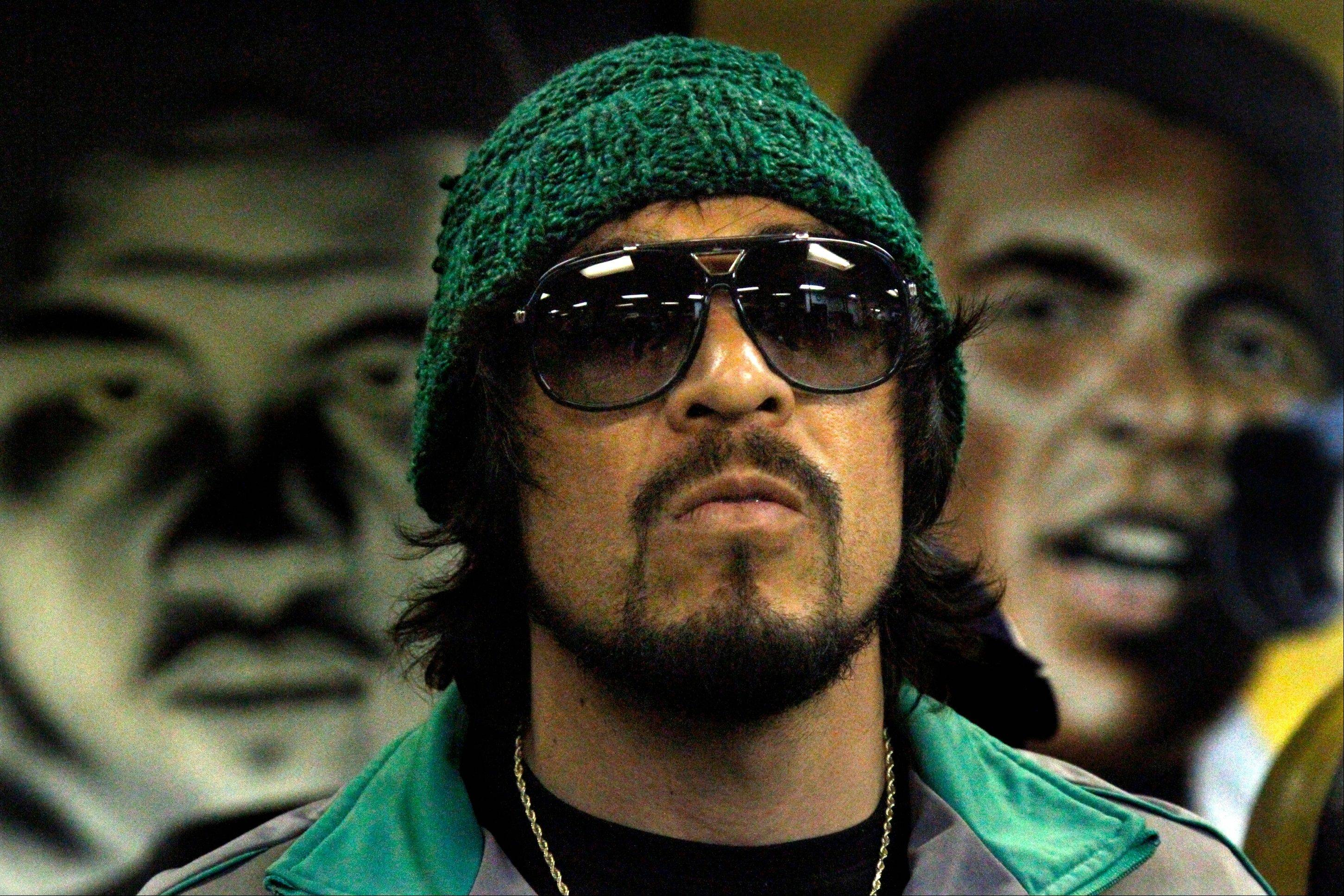 "Three time world champion boxer Antonio Margarito is framed by paintings of boxing greats Joe Louis, left, and Muhammad Ali, right, as he arrives for interviews at Kingsway Boxing Gym on Monday in New York. Margarito will challenge current WBA Super Welterweight World Champion Miguel Cotto in the feature event in a night of boxing billed as ""Cotto Margarito II,"" at Madison Square Garden on Saturday."