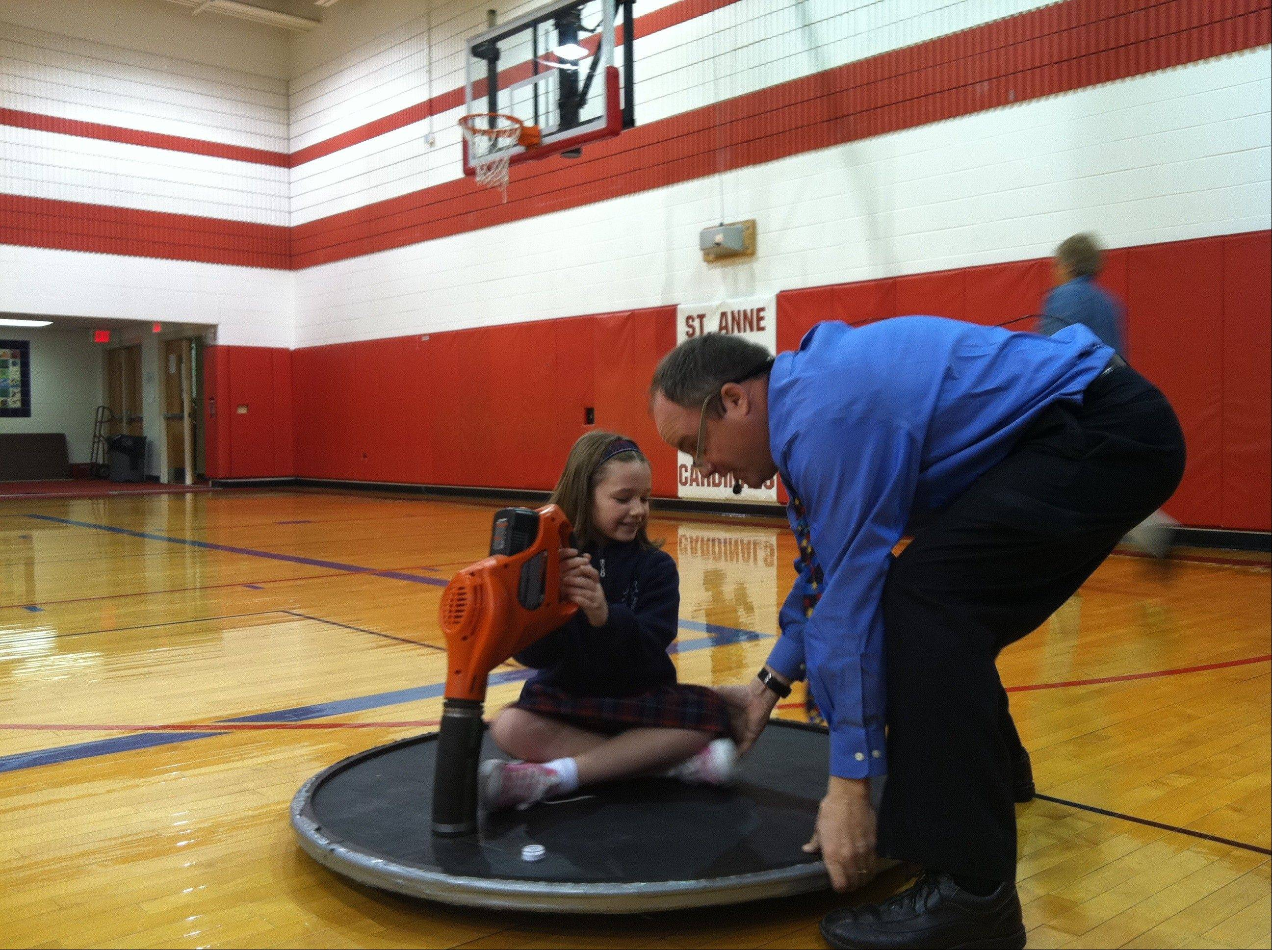 St Anne School fourth-grader Sofia Zitella takes a ride on a hovercraft.