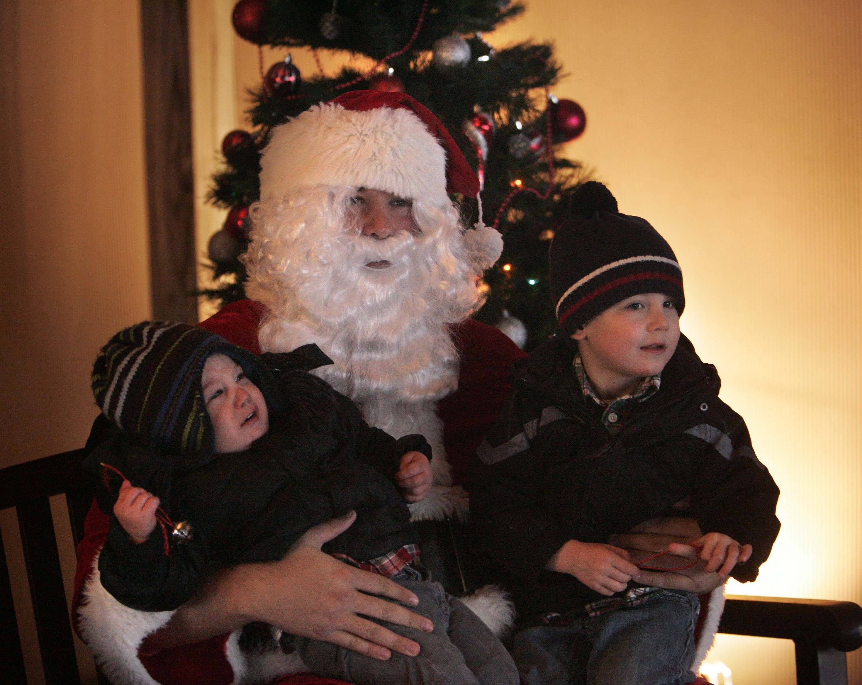 Fifteen-month-old Will Korbmacher of Geneva is not quite as sure about the man with the big white beard as his 3-year-old brother, Dylan. The boys sat on Santa's lap Saturday during the Geneva Park District's Polar Express event at Peck Farm Park.